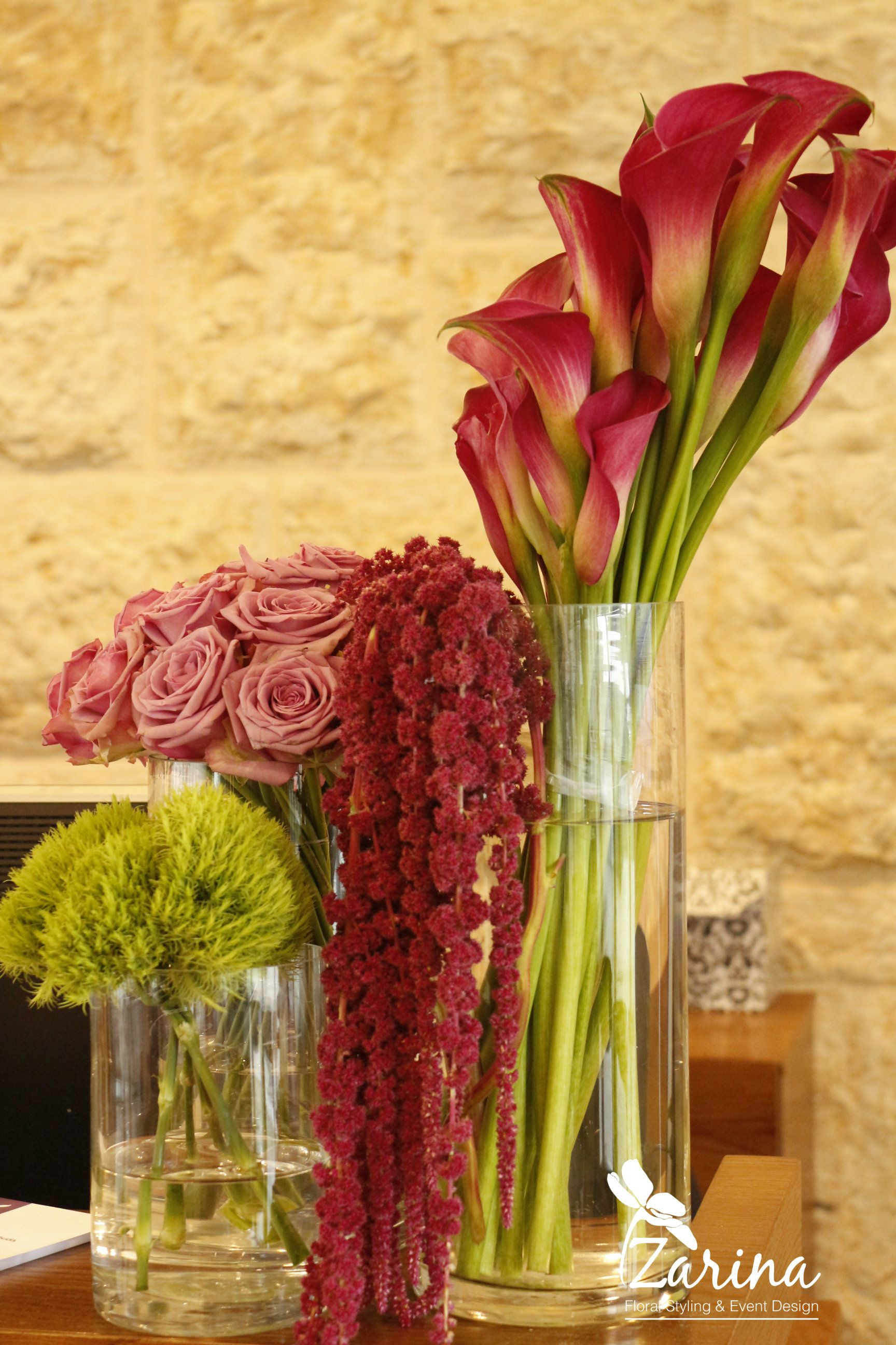 cool water roses calla lily amaranthus and carnation