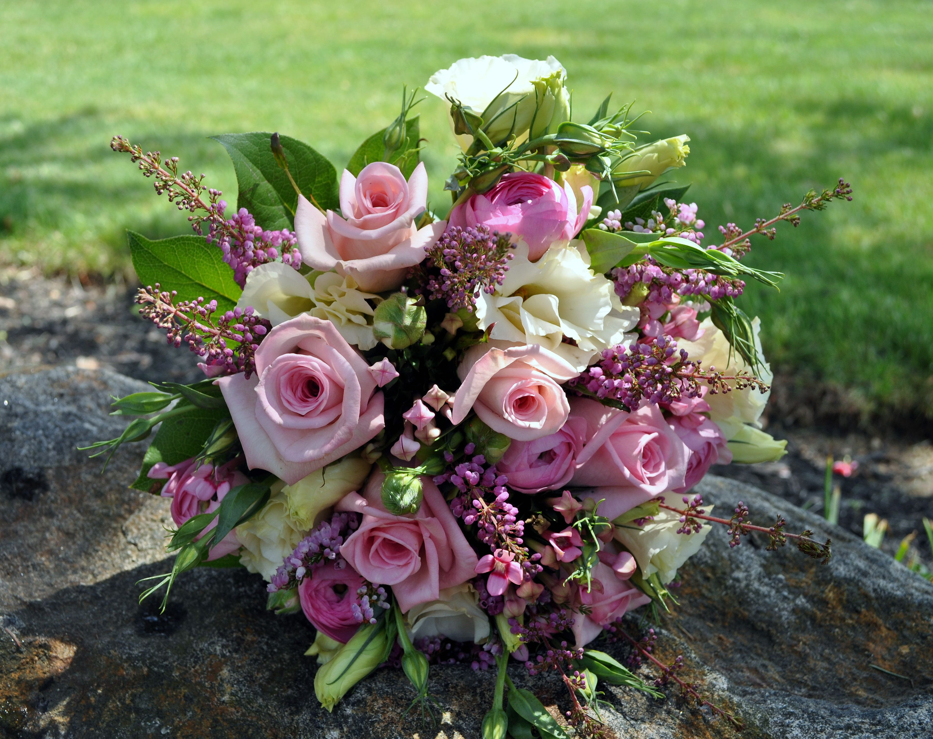 Bouquet with pink roses heather lisianthus ranunculus and bouvardia