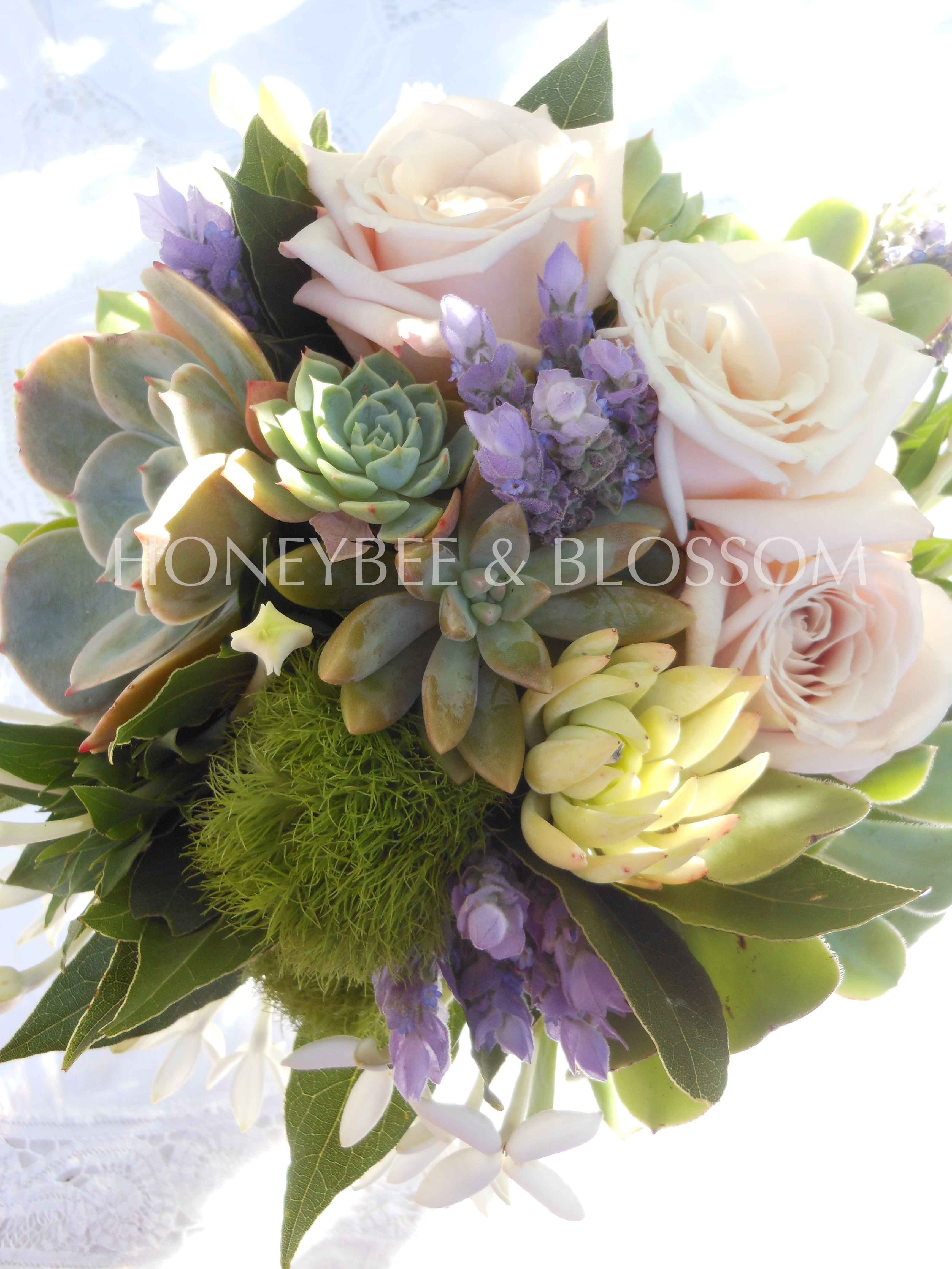 Champagne roses succulents lavender bouvardia and green trick carnation