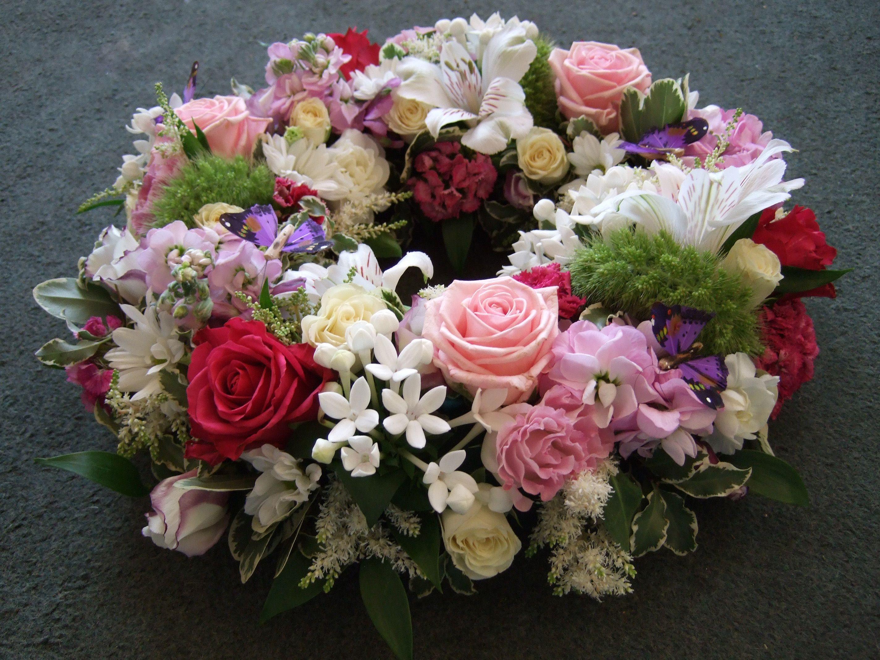 mixed flowers wreath with roses Lisianthus stocks and bouvardia
