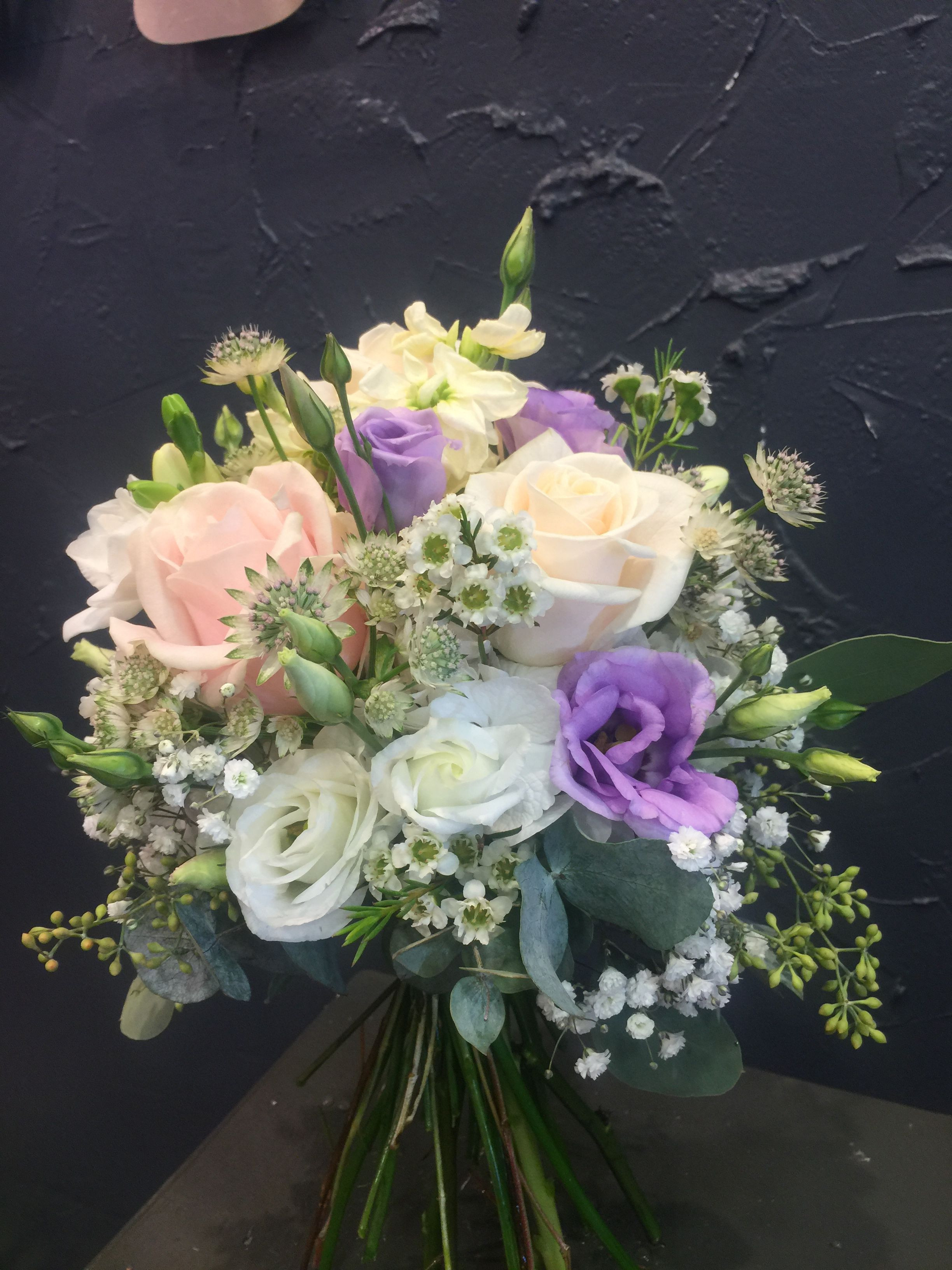 Attractive Bridal bouquet with Sweet Avalanche roses lisianthus astrantia wax flowers gypsophila