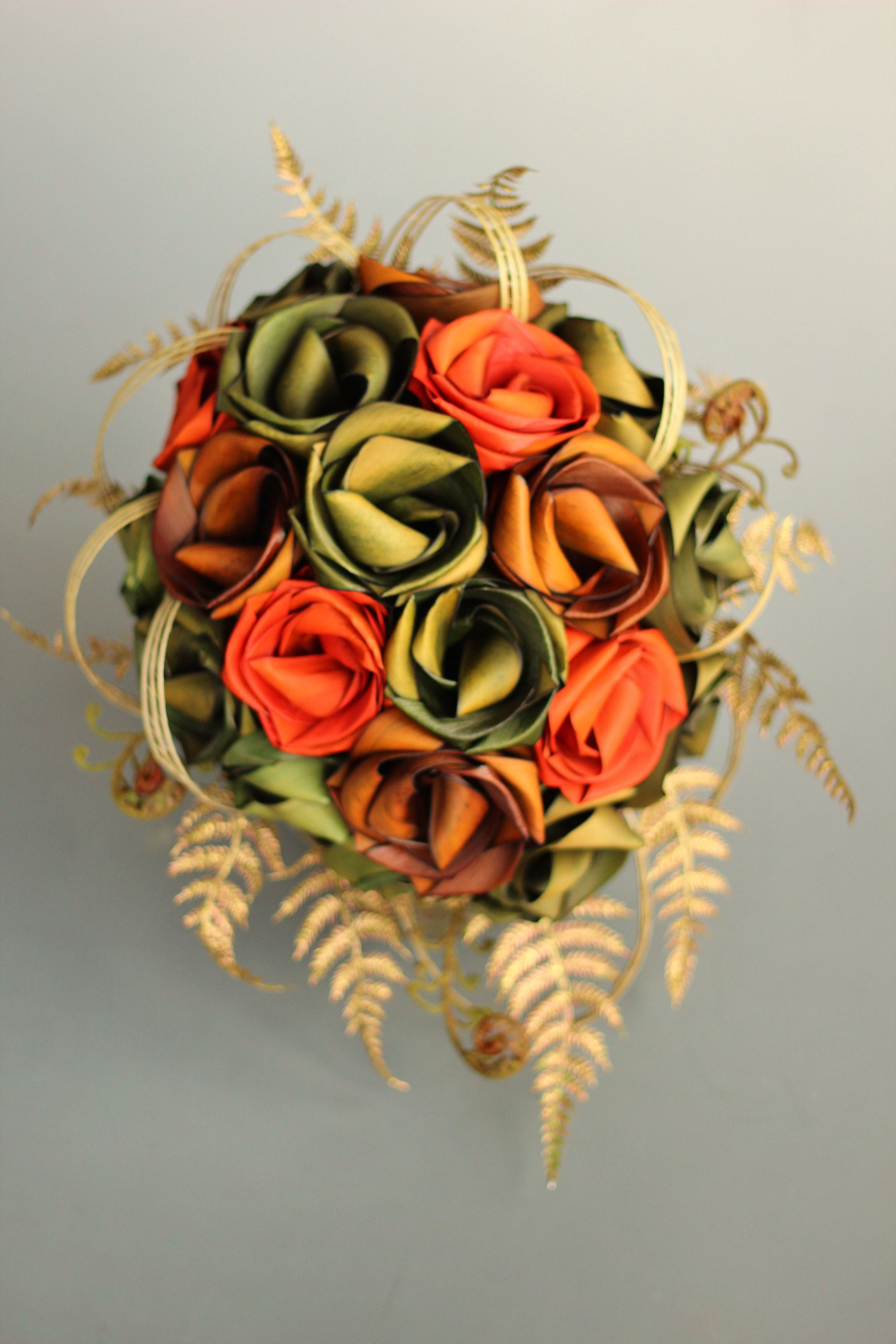Teardrop flax flower wedding bouquet by Flaxation Orange sage and mid brown flax flowers