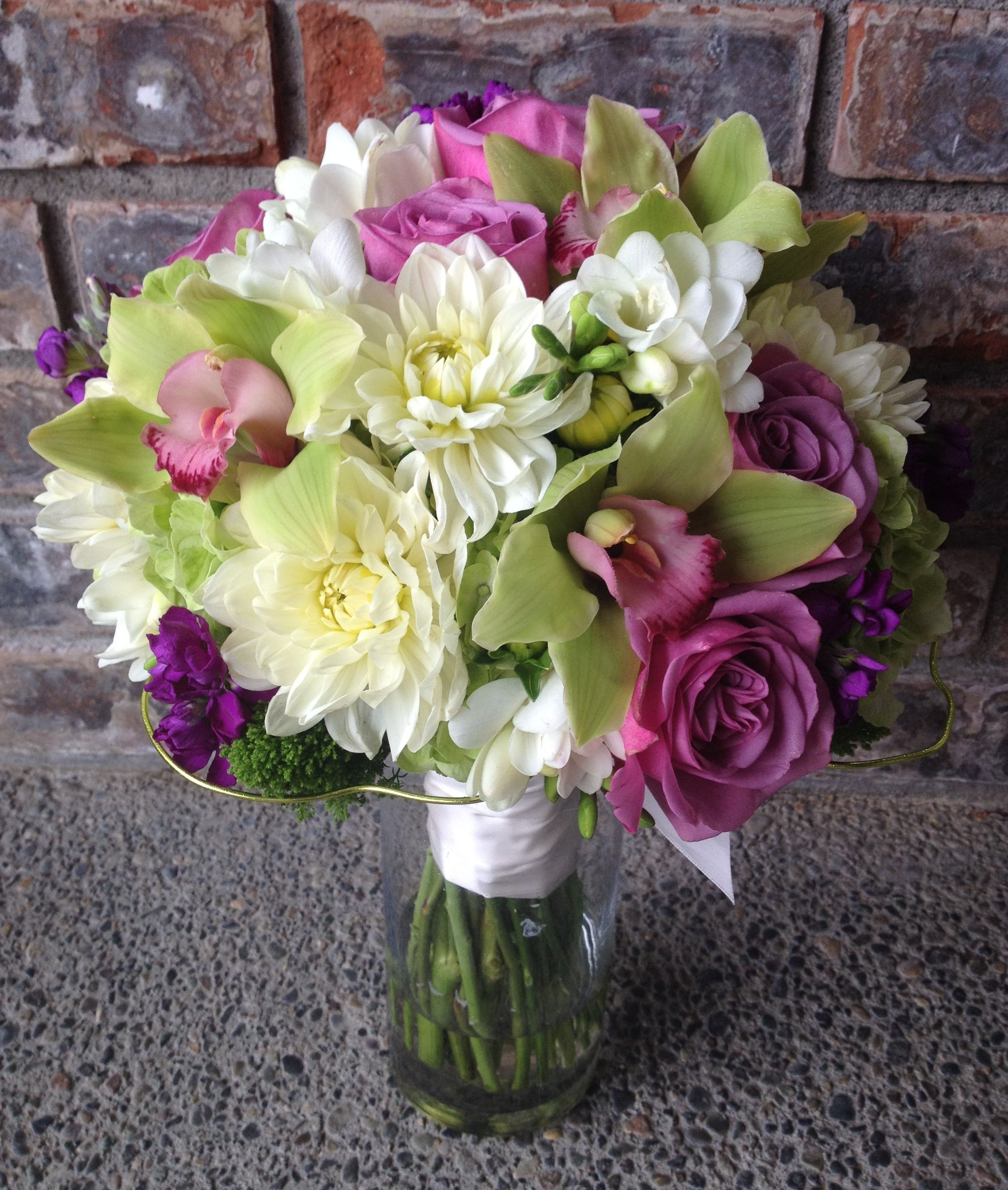 green hydrangea white dahlias white freesia lavender roses purple stock and green