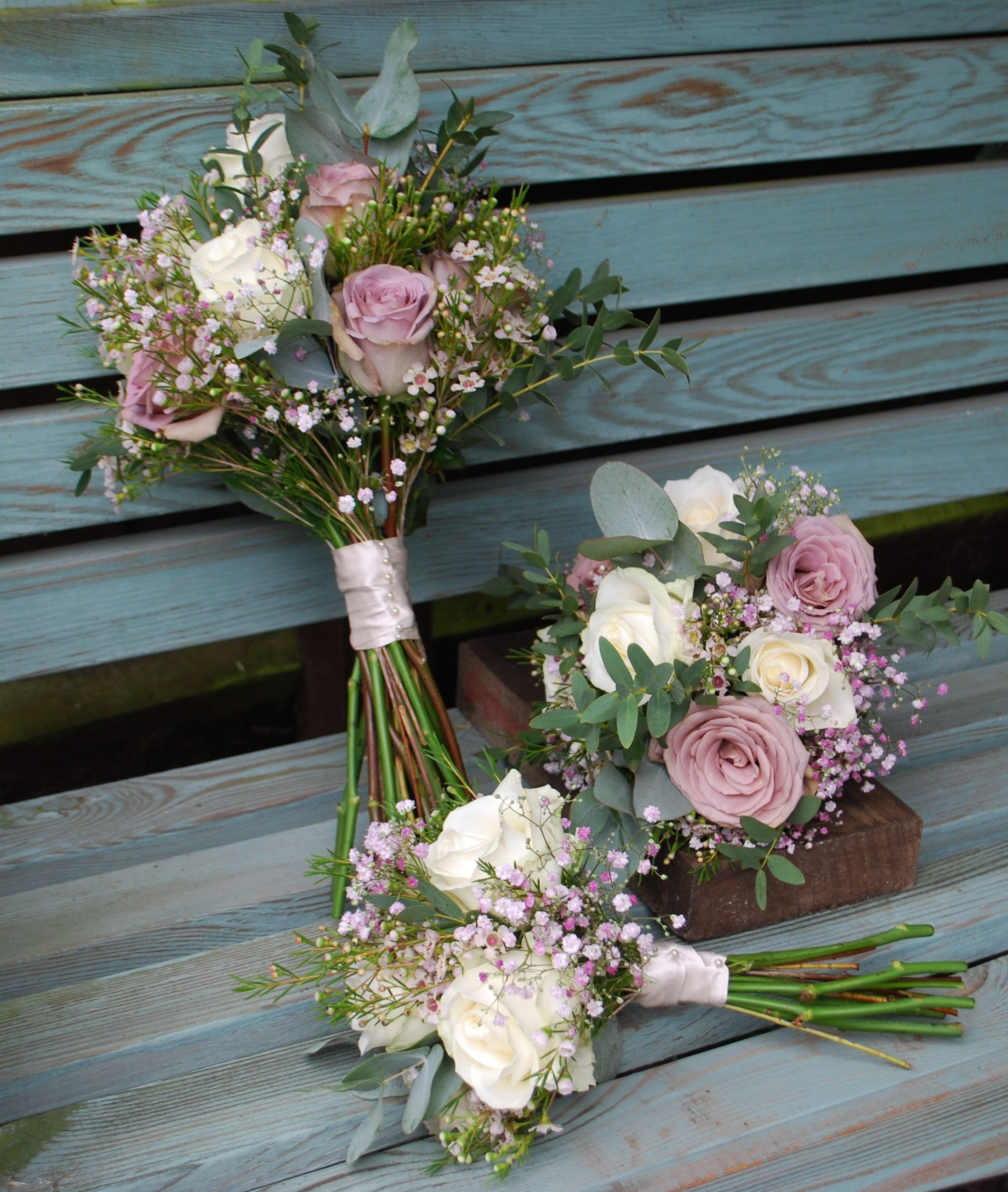 Vintage rose and gypsophila bridal bouquet pretty with coin eucalyptus and waxflowers mixed in