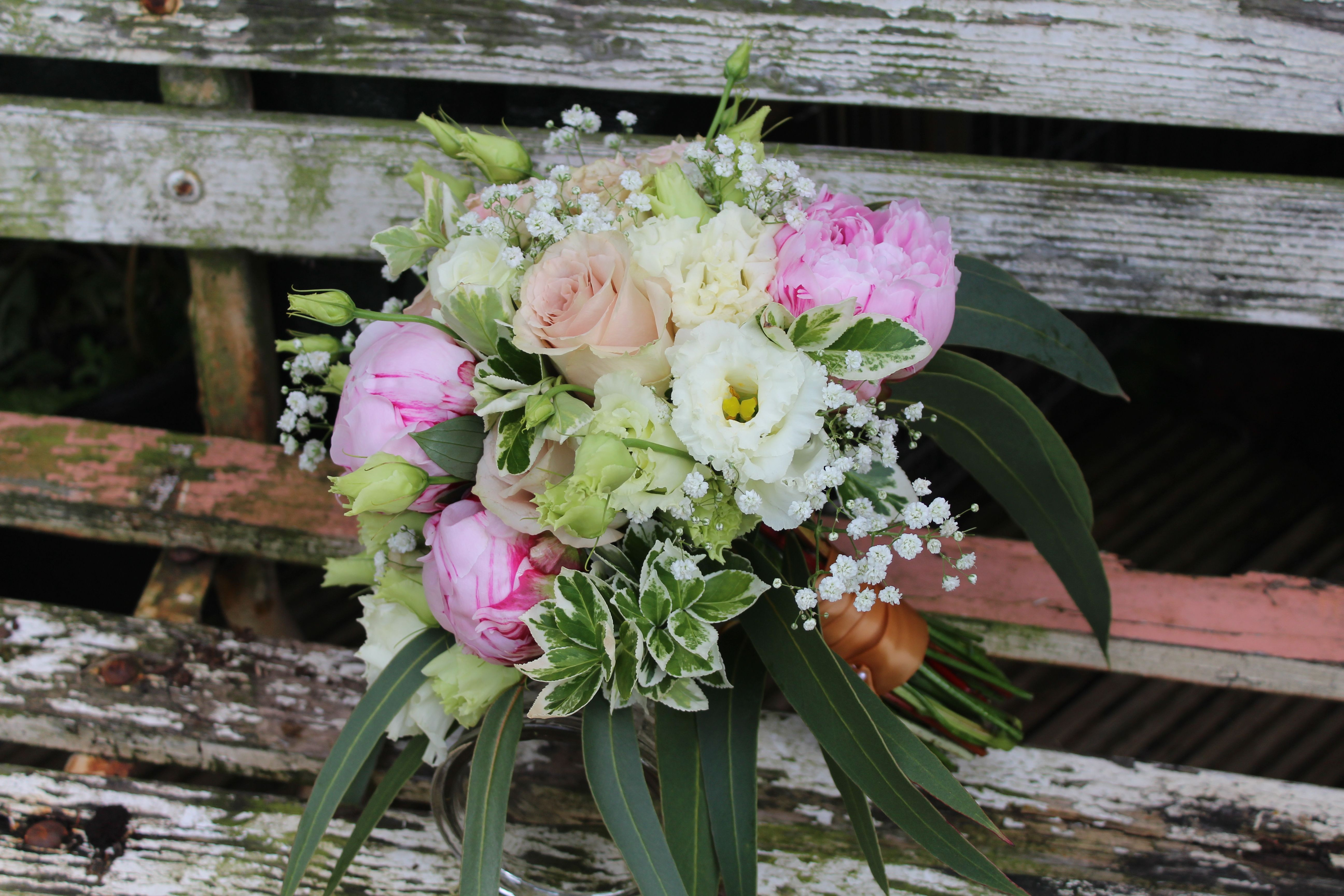 Wedding bouquet in light and blush pinks with peonies roses lizianthus gypsophila and