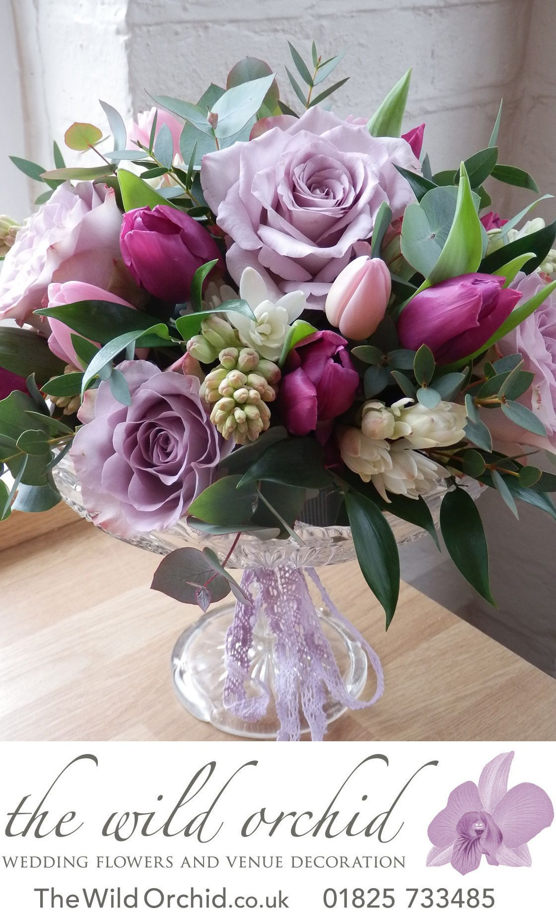 A vintage glass sweet cake stand decorated with lilac memory lane roses pink and