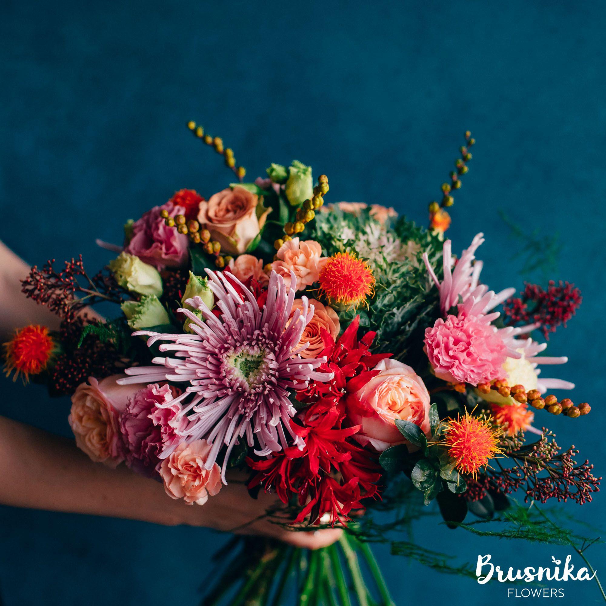 Bright bouquet of capuccino rose spray roses carthamus crocosmia chrysanthemum asparagus