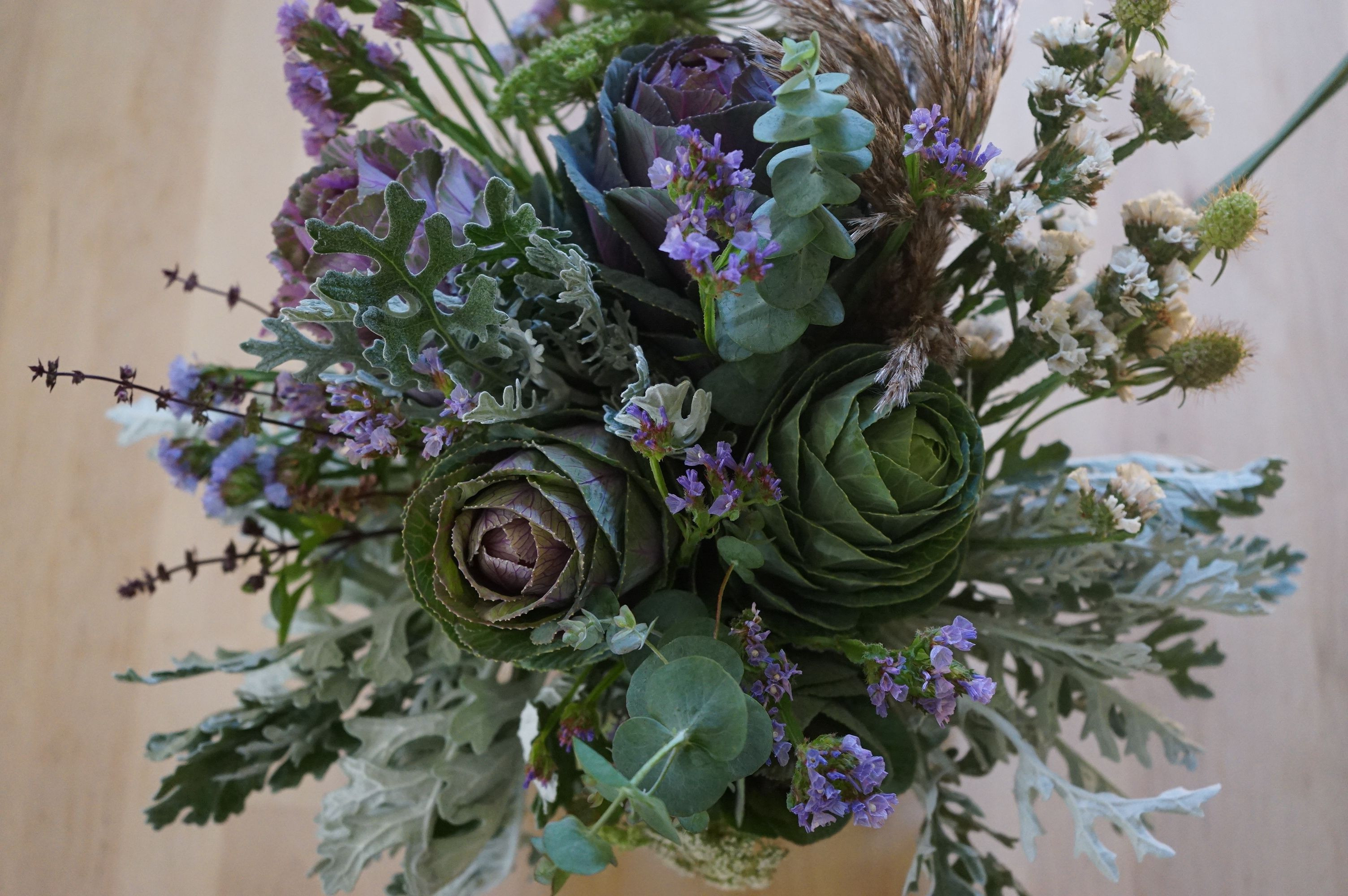 fall bouquets featuring kale flowers dusty miller statice grasses