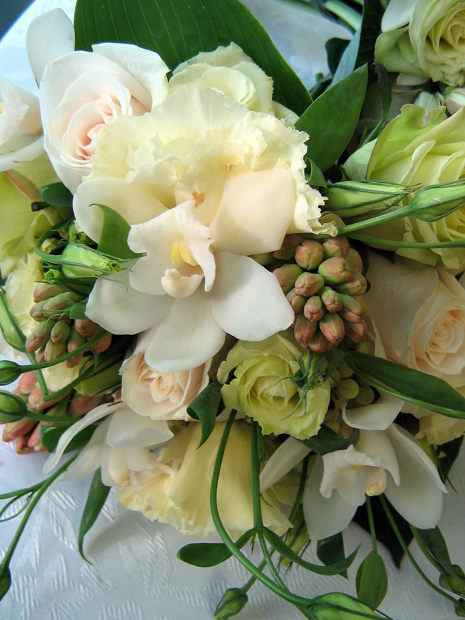 Bride s bouquet with tuberose orchid lisianthus and roses Wedding Flowers Weddings Niagara
