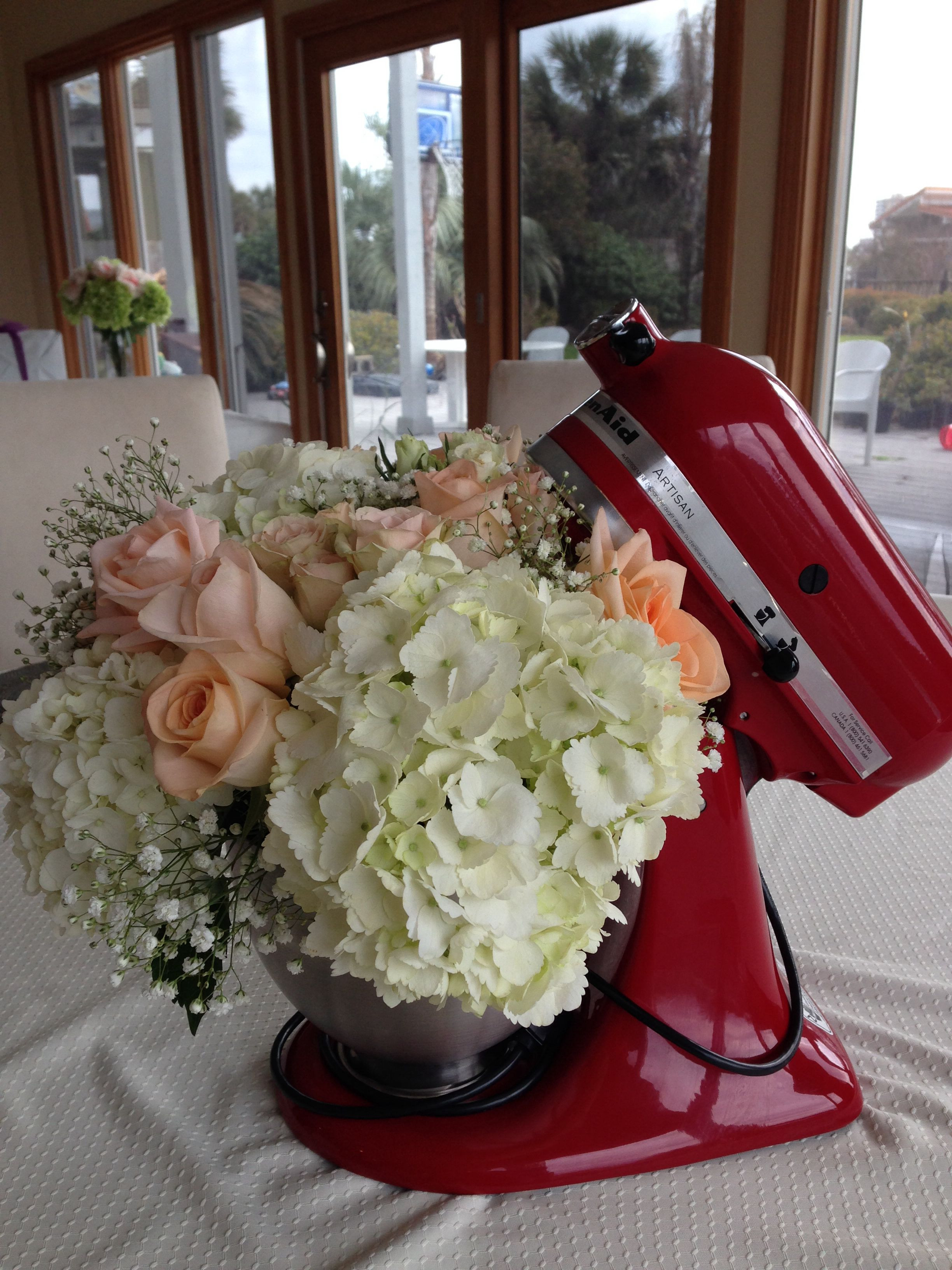 Kitchen themed wedding shower flower arrangement inside of a kitchen aid