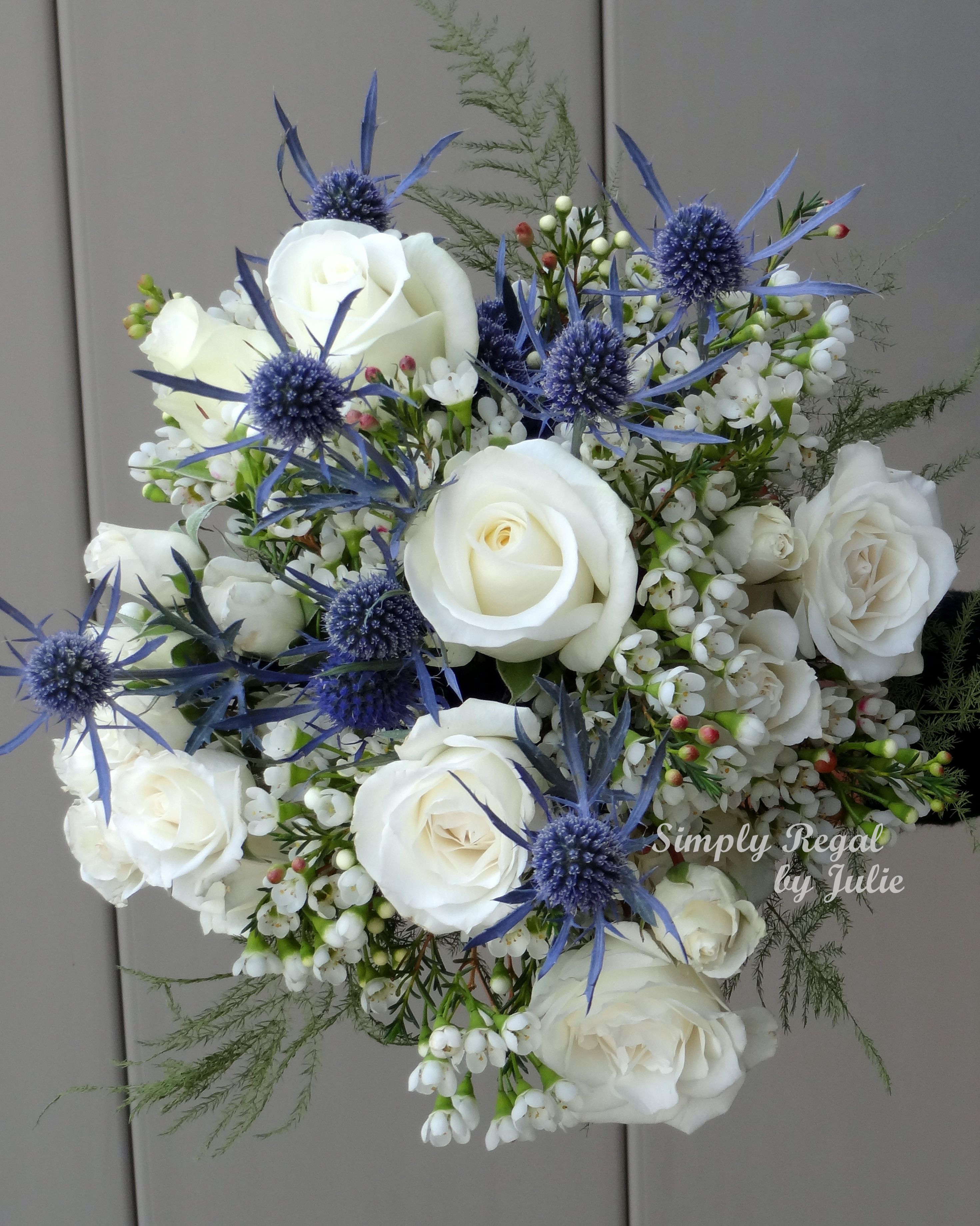 Bouquet with White Roses Blue Thistle and White Waxflower Simply Regal by Julie