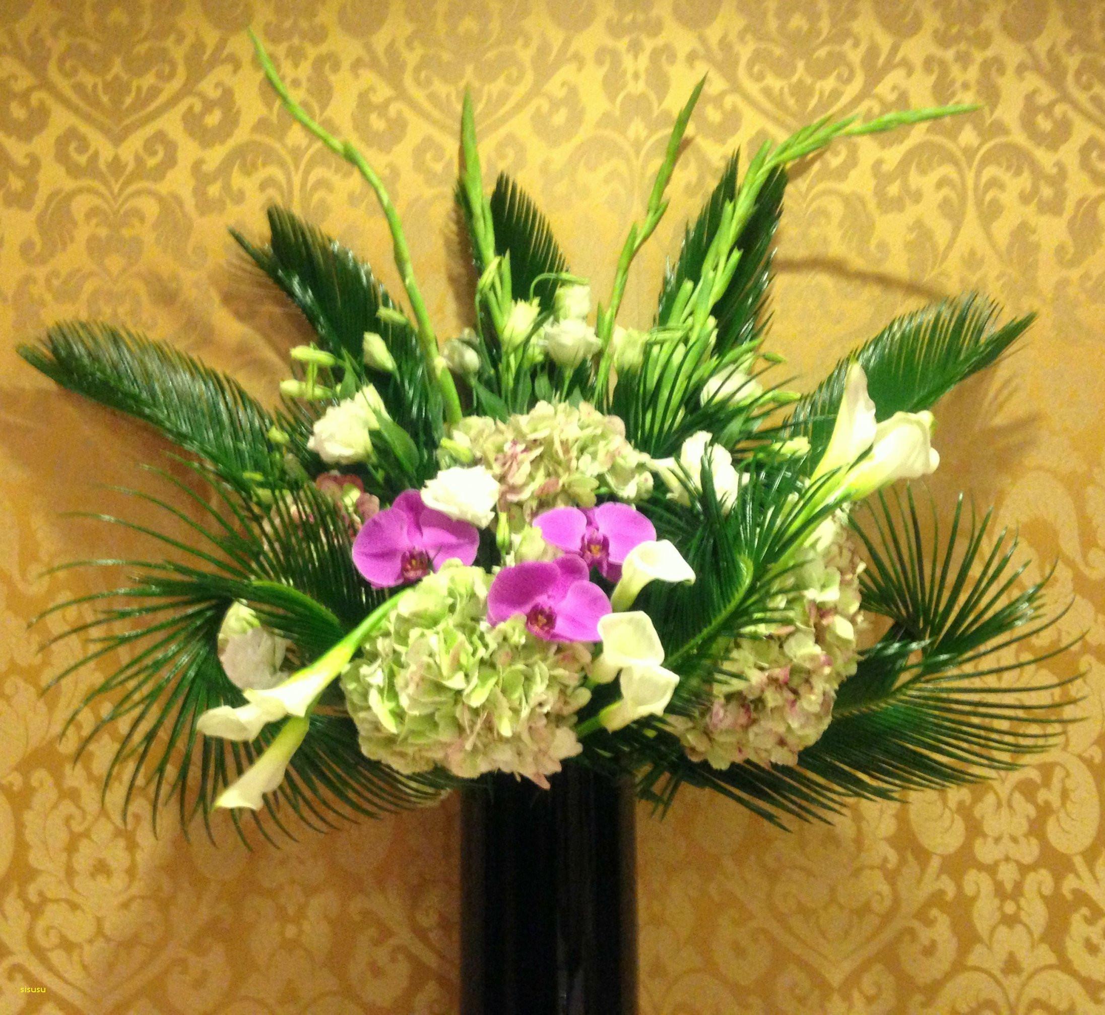 Hotel Lobby Flowers A tall arrangement of Hydrangeas White Callas and Gladiolas and fabulous Purple Phalaenopsis