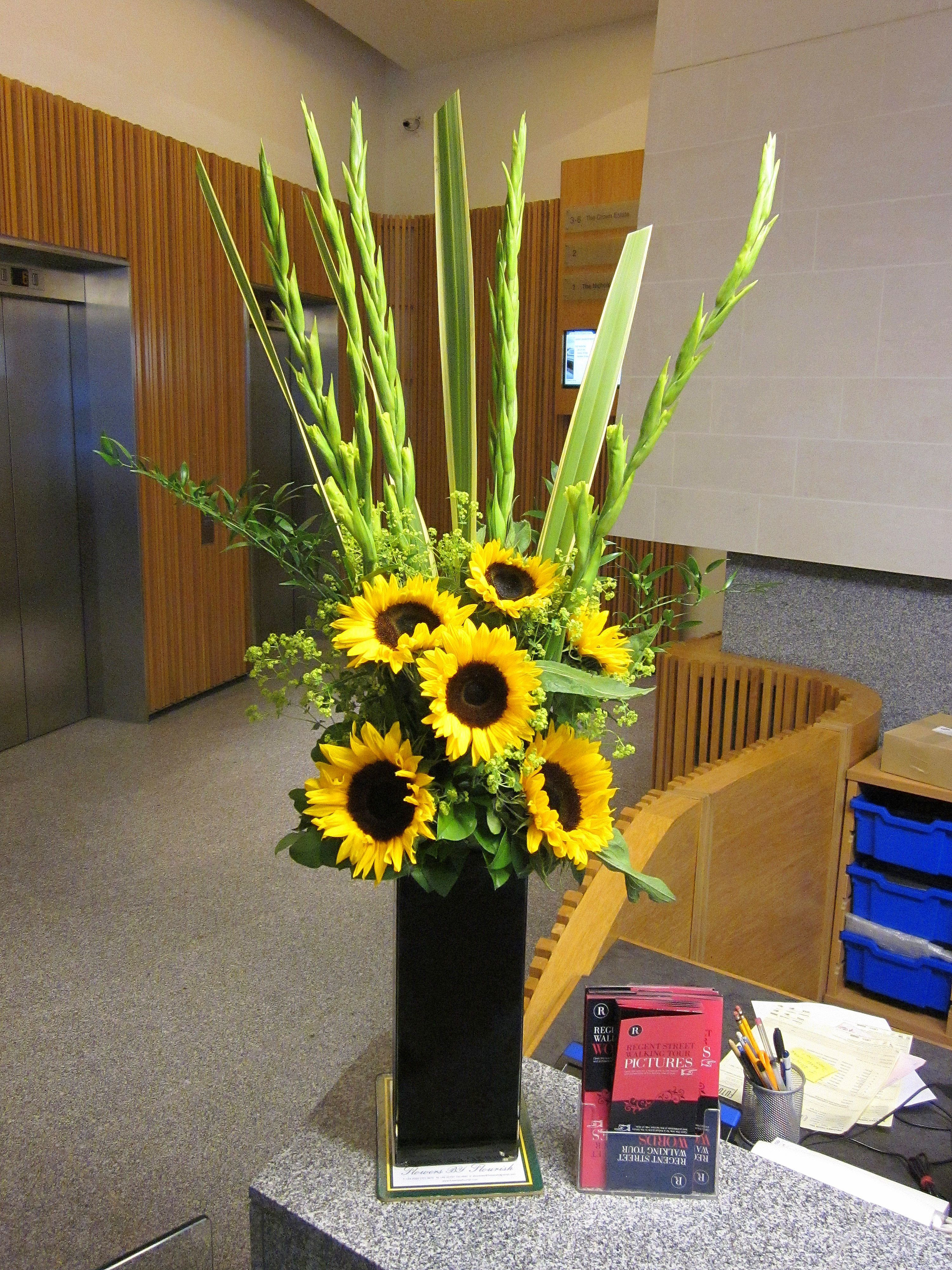 Image result for orange gladiolus and sunflower arrangement