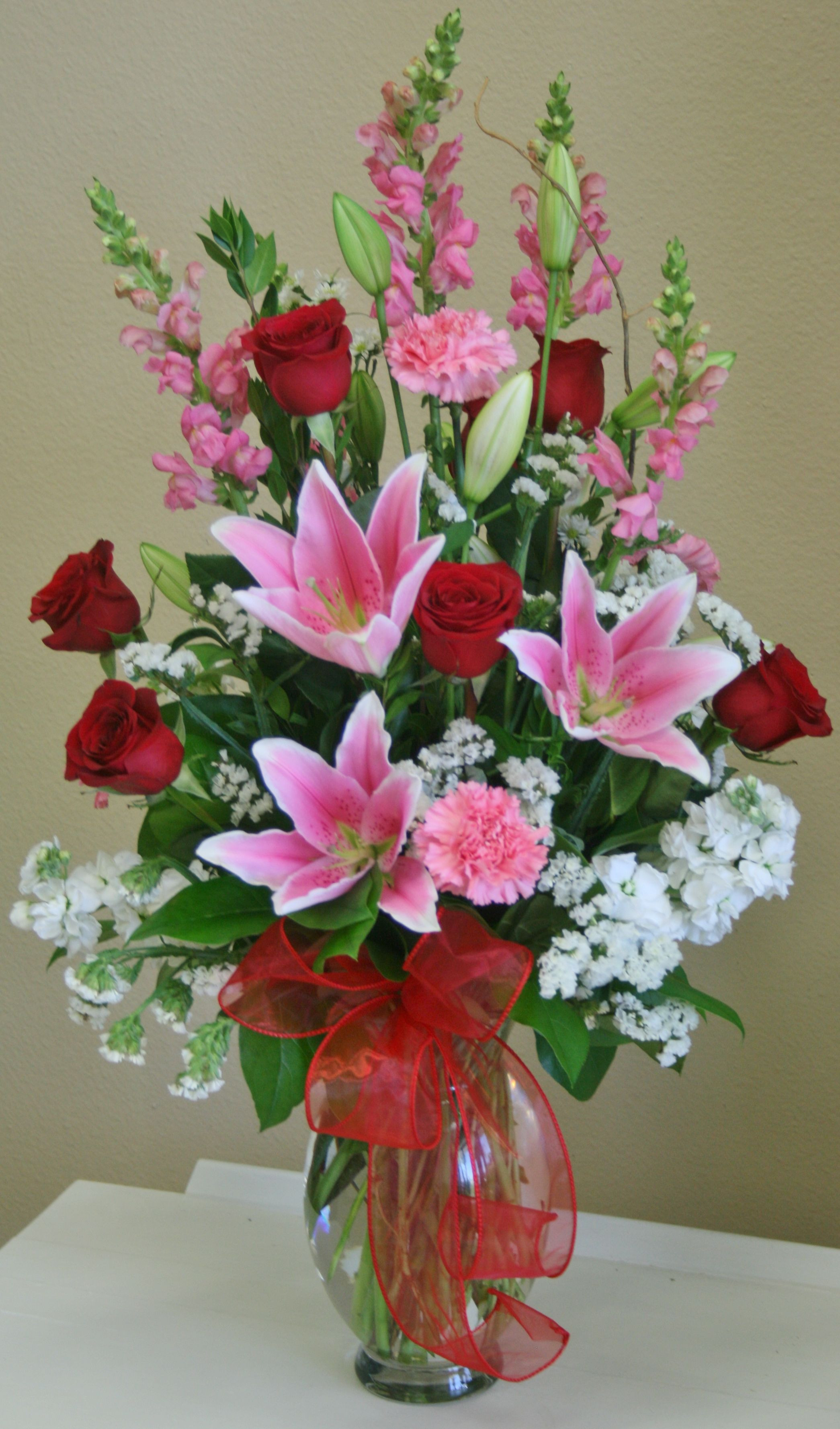 A romantic red white and pink flower arrangement by your local Riverside florist Willow Branch Florist of Riverside