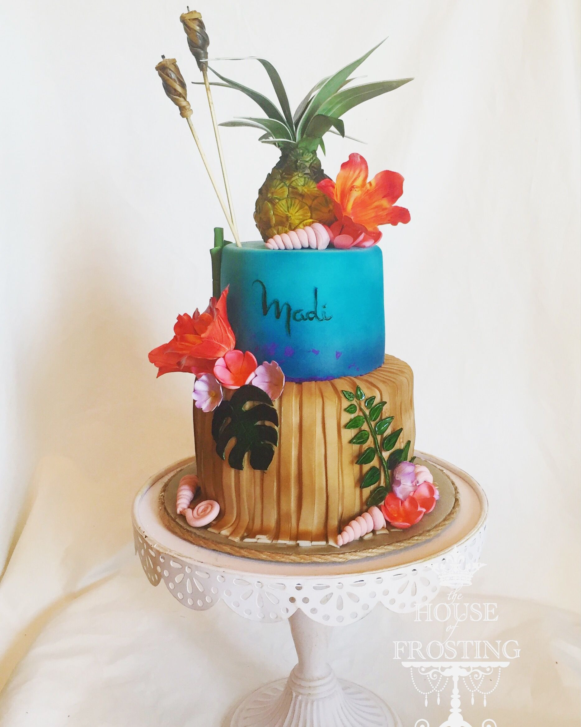Hawaiian birthday cake with fondant tiki torch candles