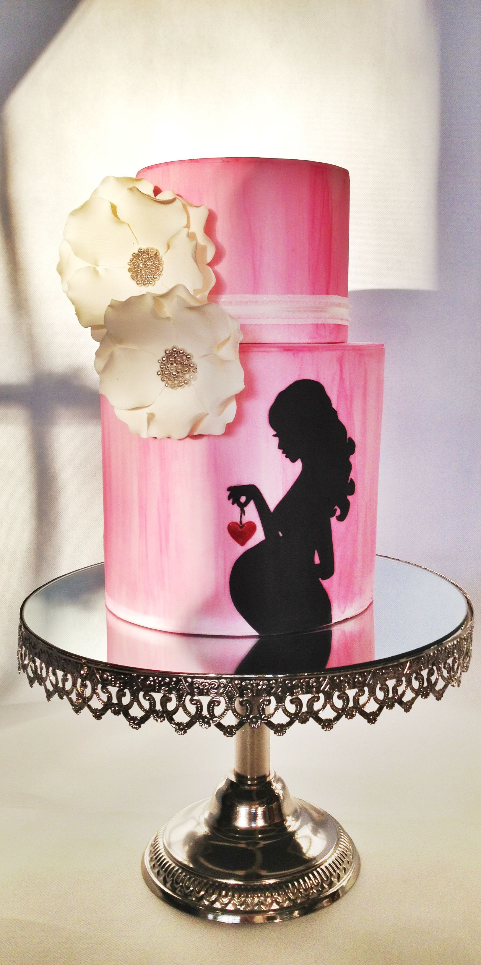 Pink baby shower cake with silhouette