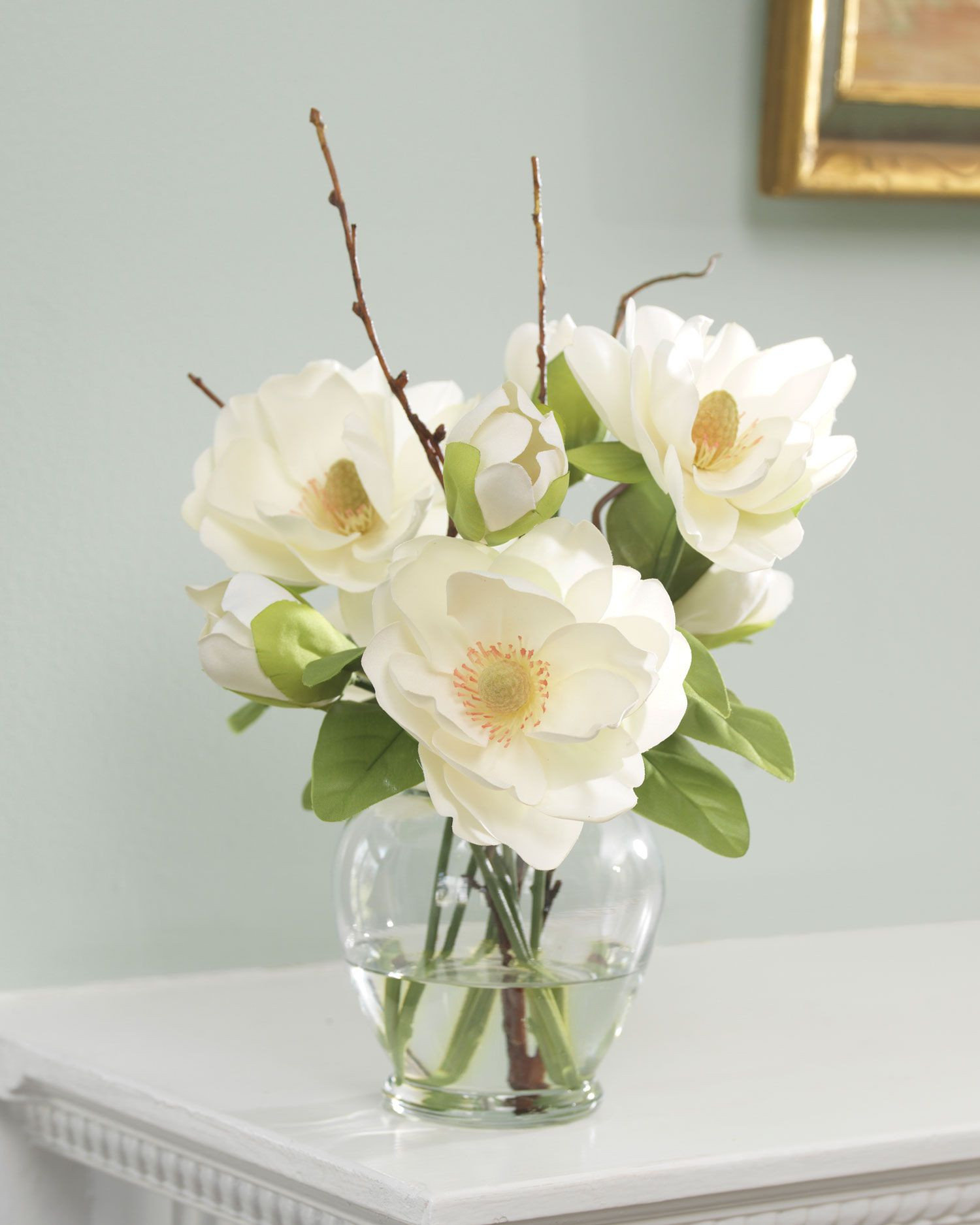 This fragrant and fragile silk magnolia flower has inspired many an artist Our ethereal arrangement of silk magnolias in whispering white may just spark