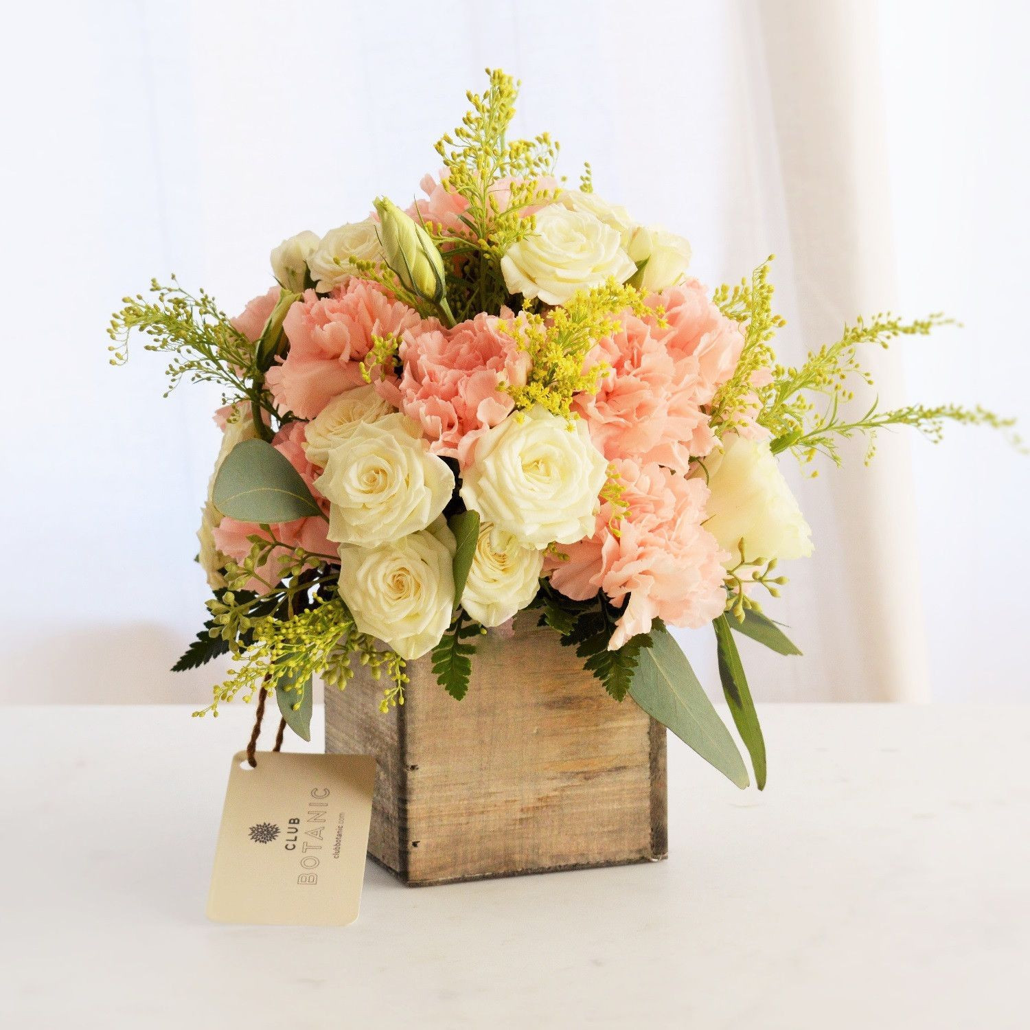 A tried and true customer favorite since we first introduced it The Allison petite features pink carnations and white spray roses to her with solidago