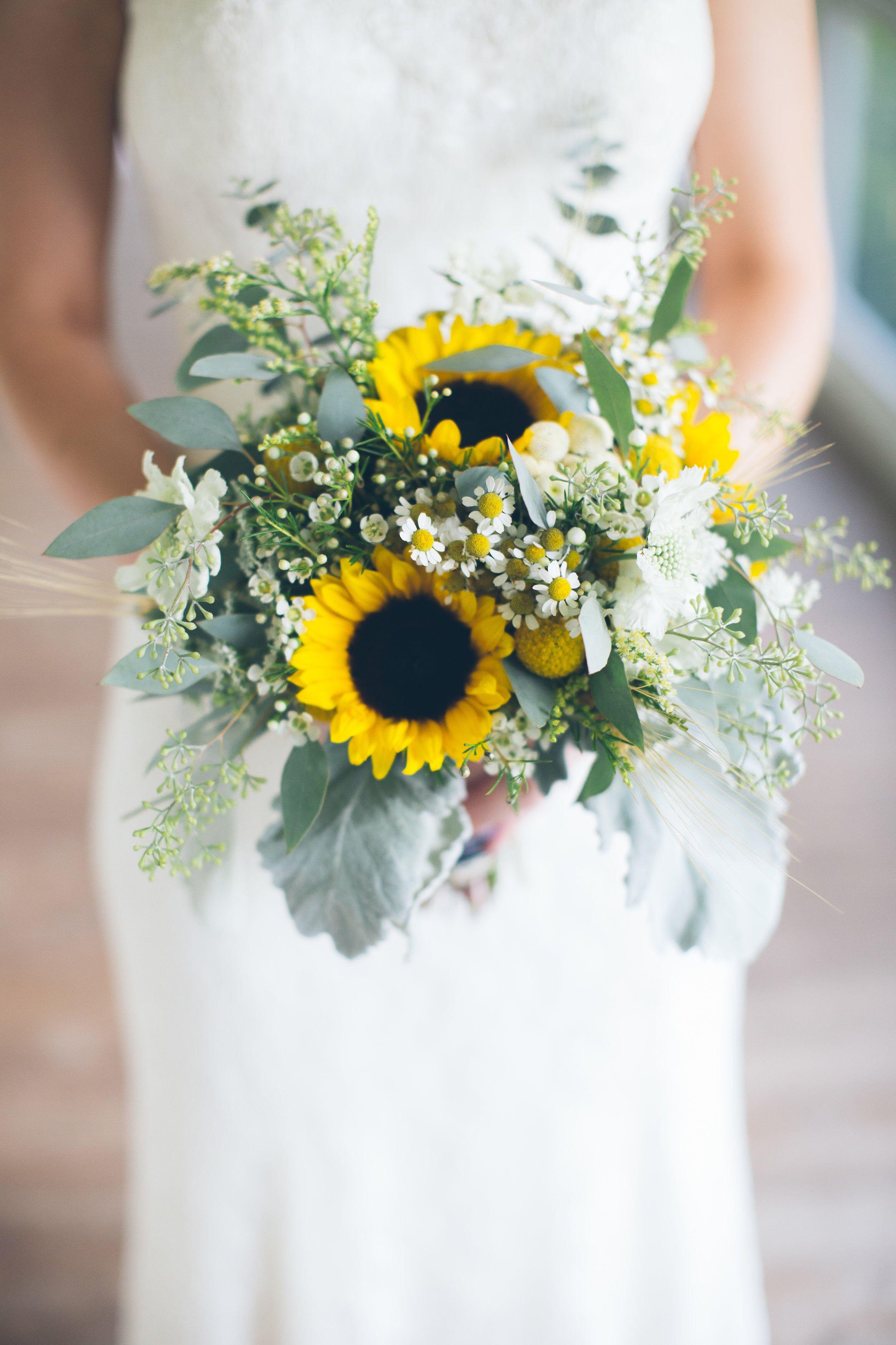 Bridal bouquets Sunflower wedding Sunflower and wheat Dusty miller fever few wax