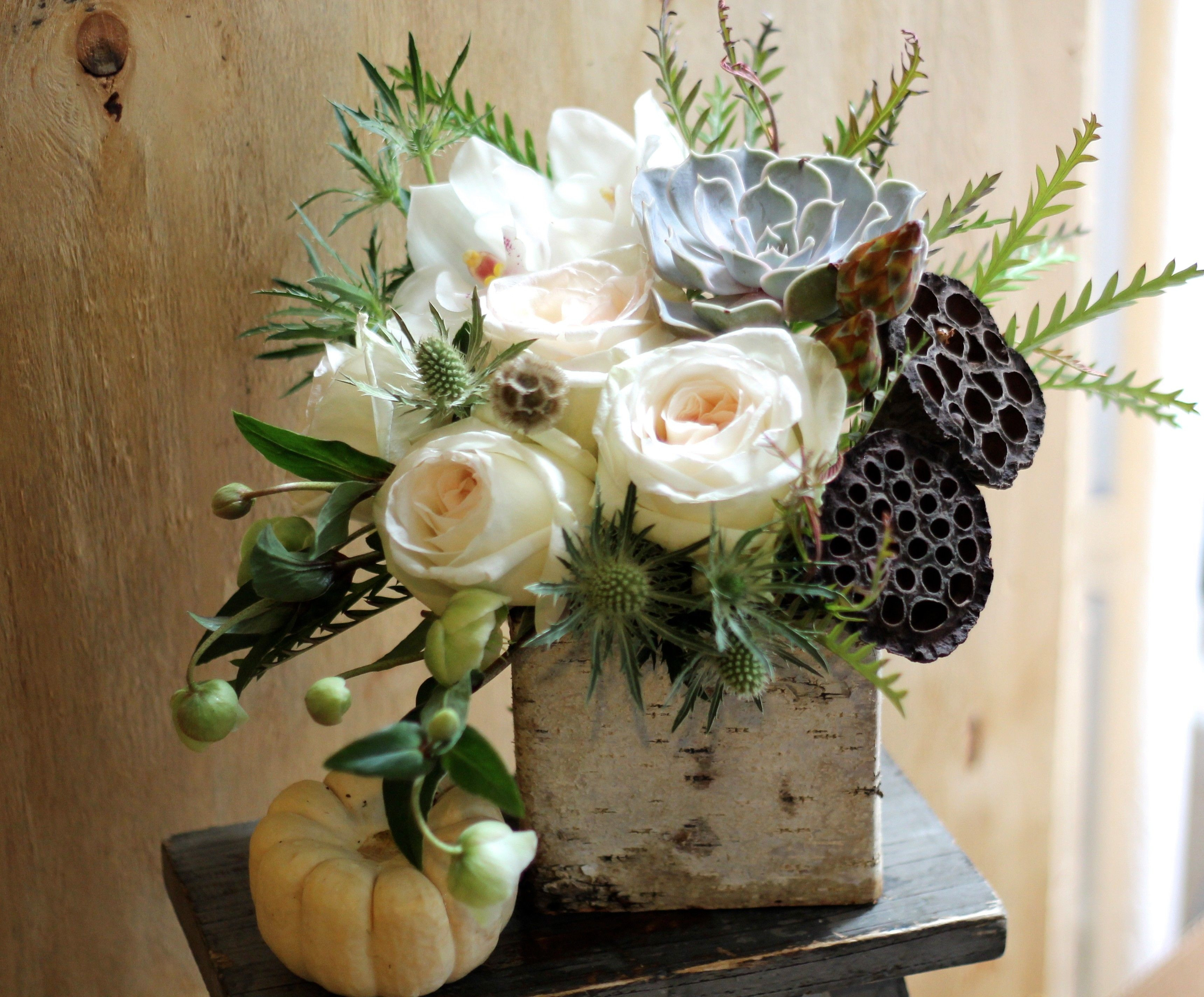 Pale roses succulent and lotus pods in birch vase Gotham Florist NY