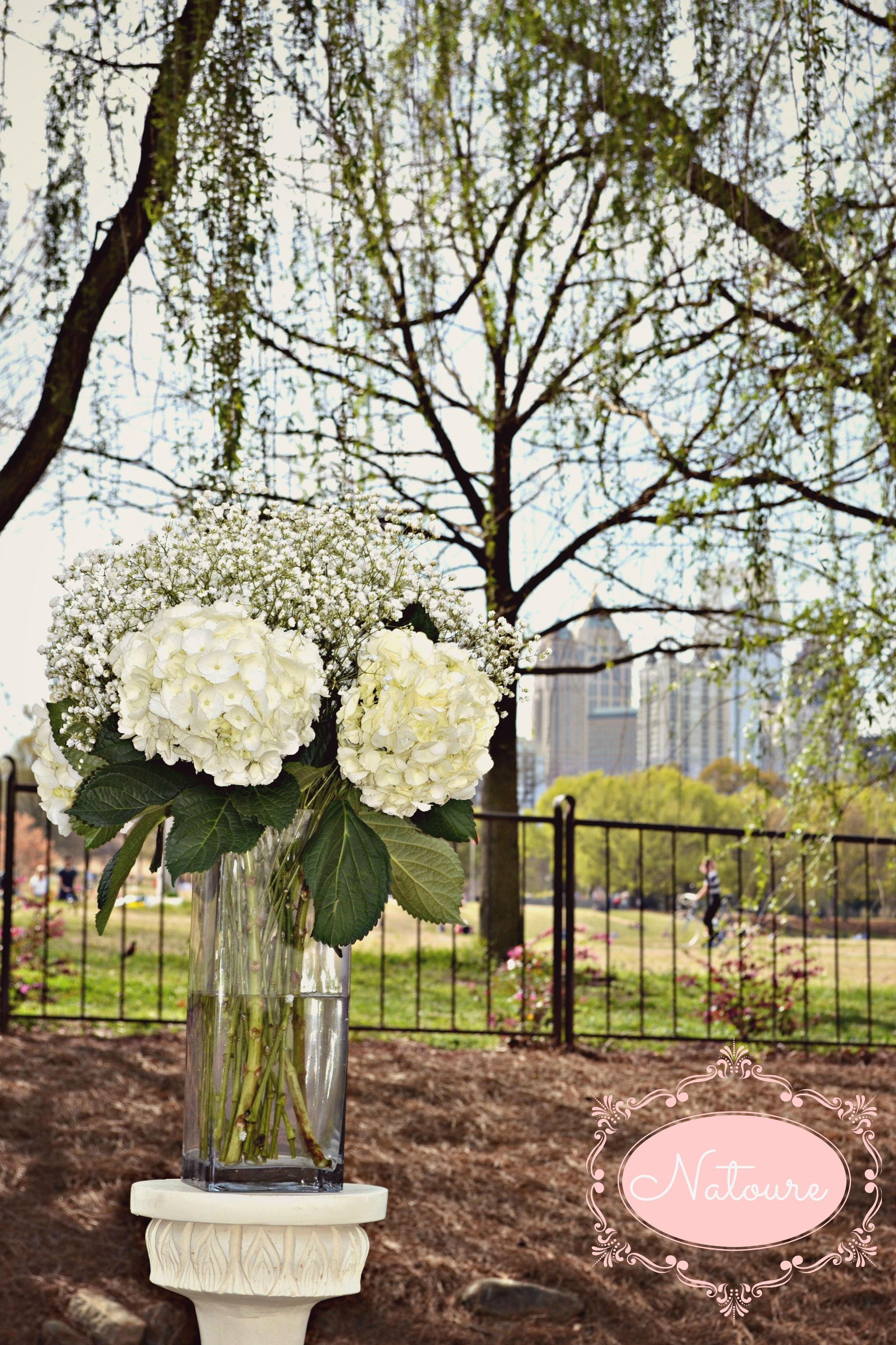 I m finding this baby s breath and hydrangea arrangement surprisingly attractive white wedding flowers