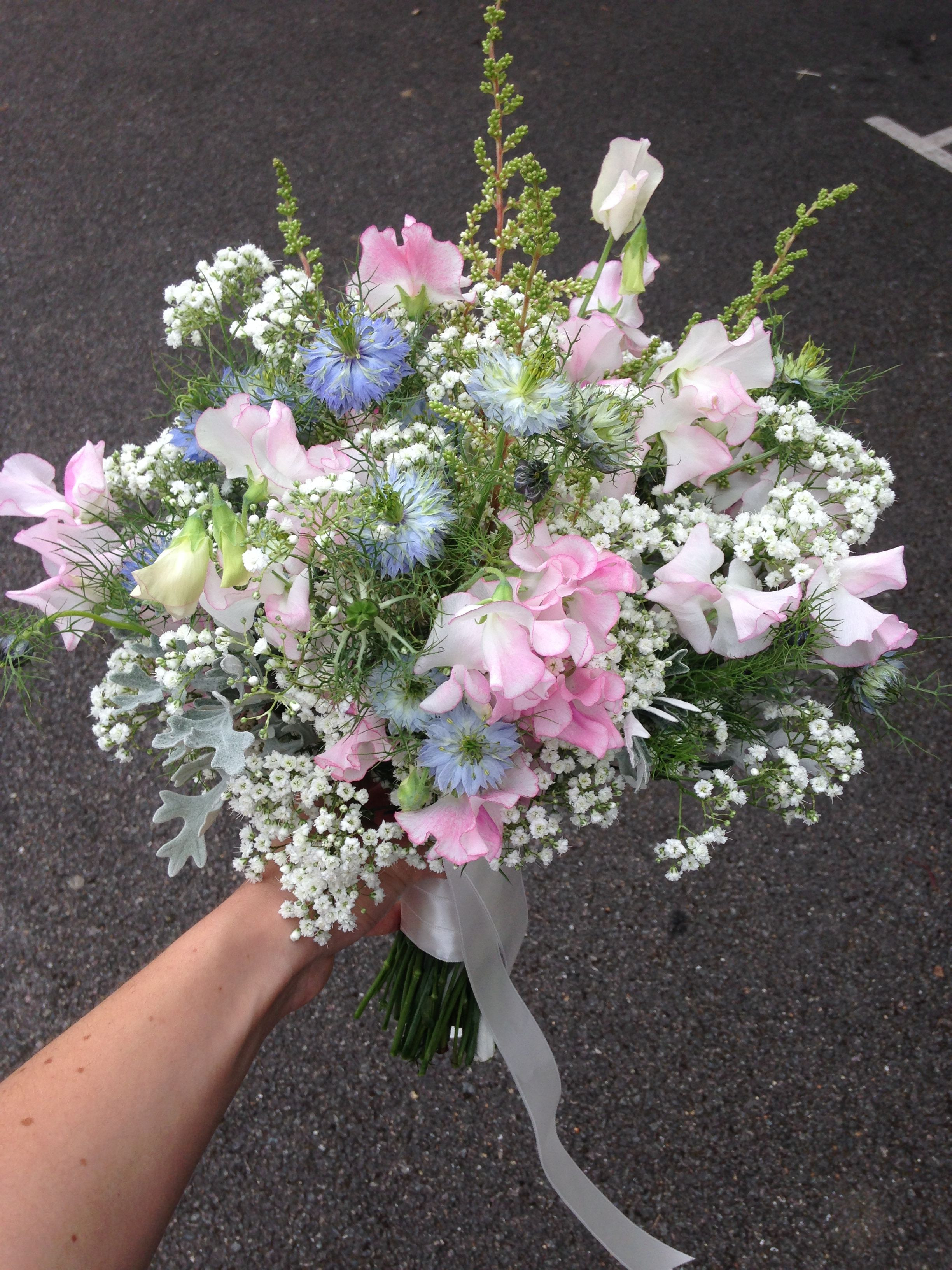 Rustic bouquet of Gypsophila Sweet Peas Astilbe and Nigella