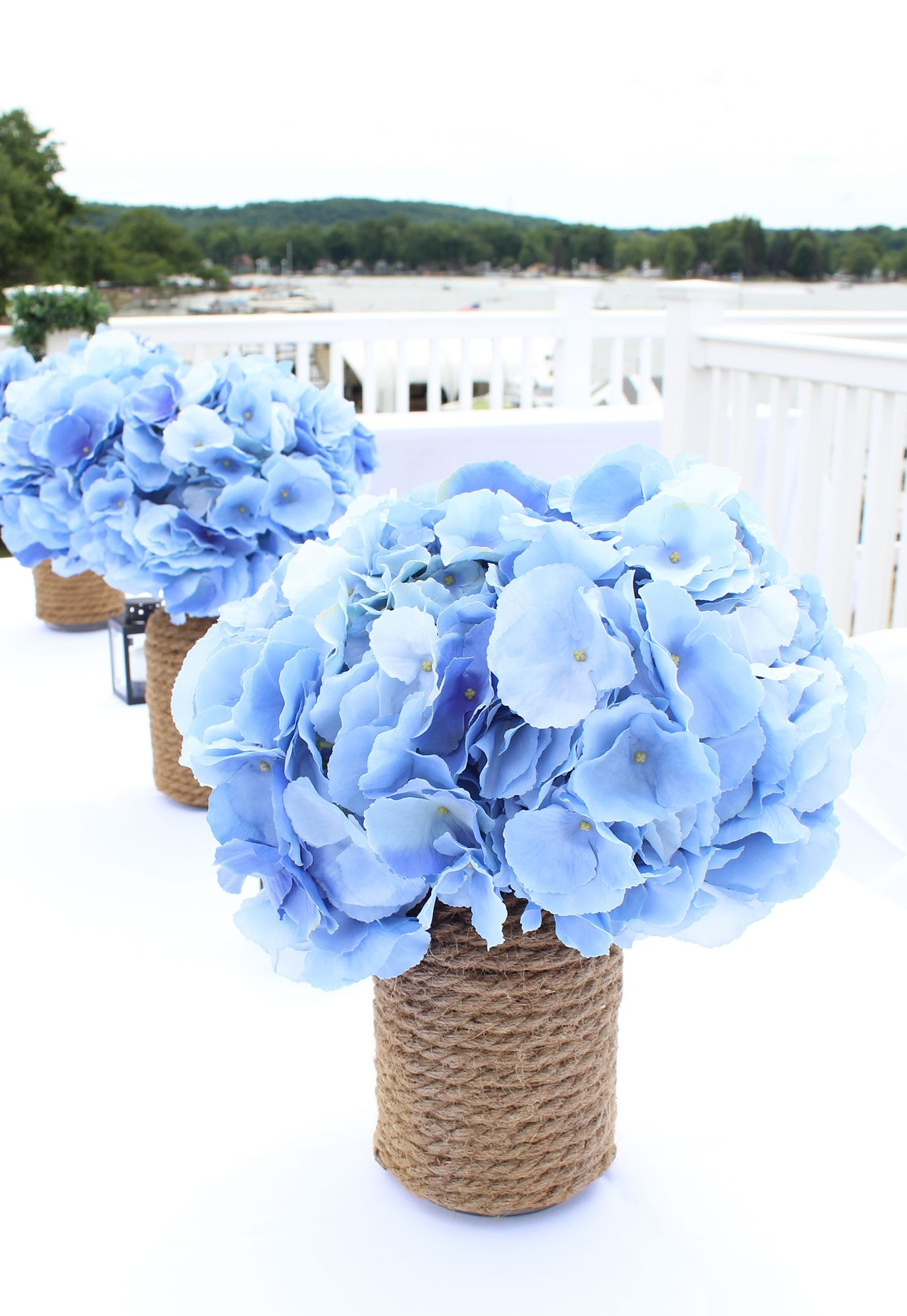 from Afloral make stunning wedding centerpieces Perfect for nautical weddings too Bring in your something blue with blue wedding flowers