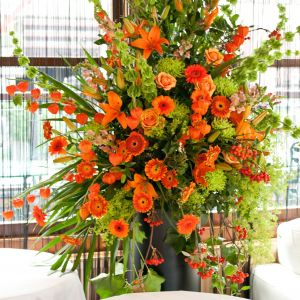 Flower Delivery Des Moines Awesome orange and Lime Green Flower Pedestal Arrangement Suitable to
