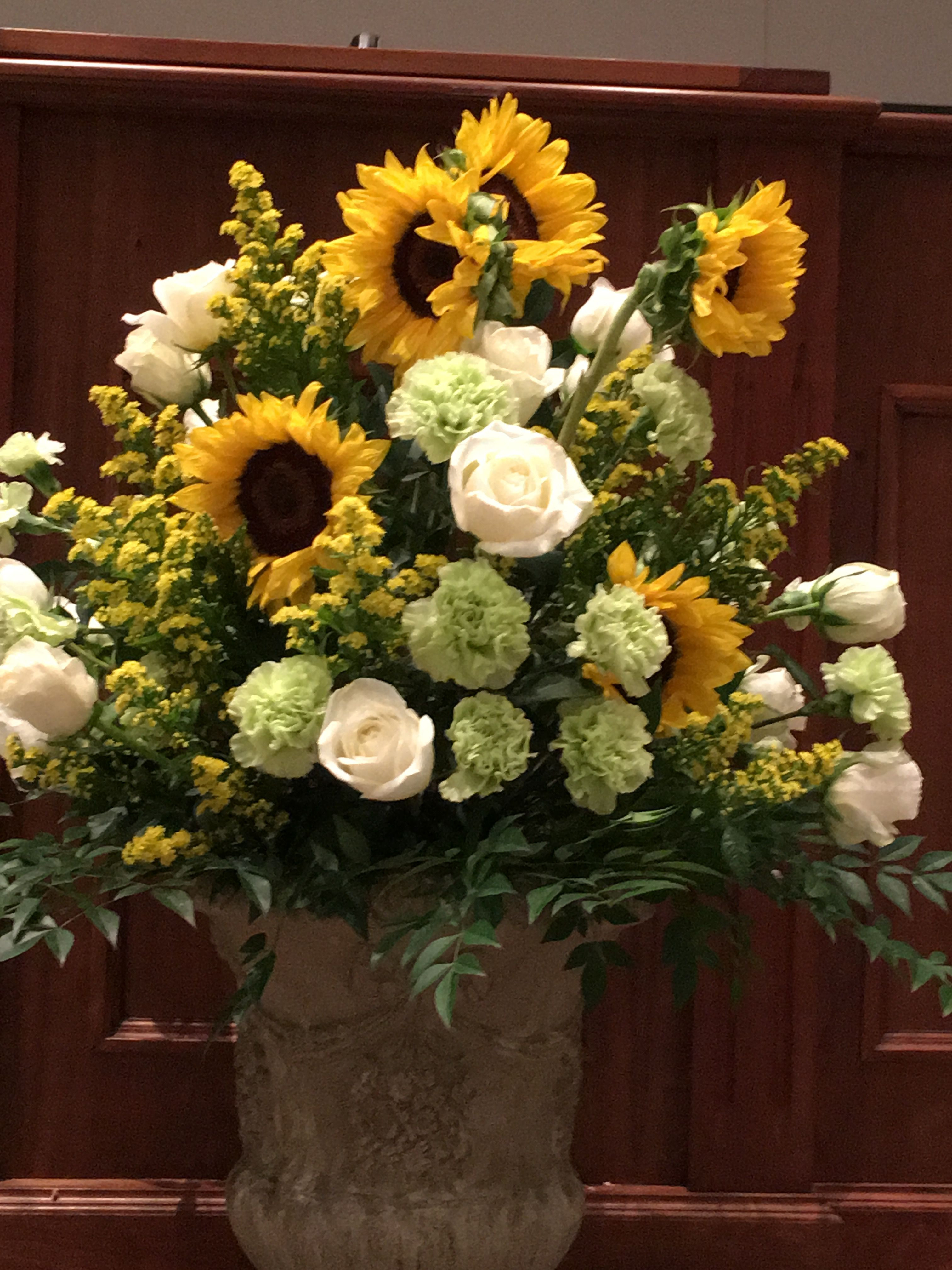 Formal flowers like roses look great with rustic informal Sunflowers