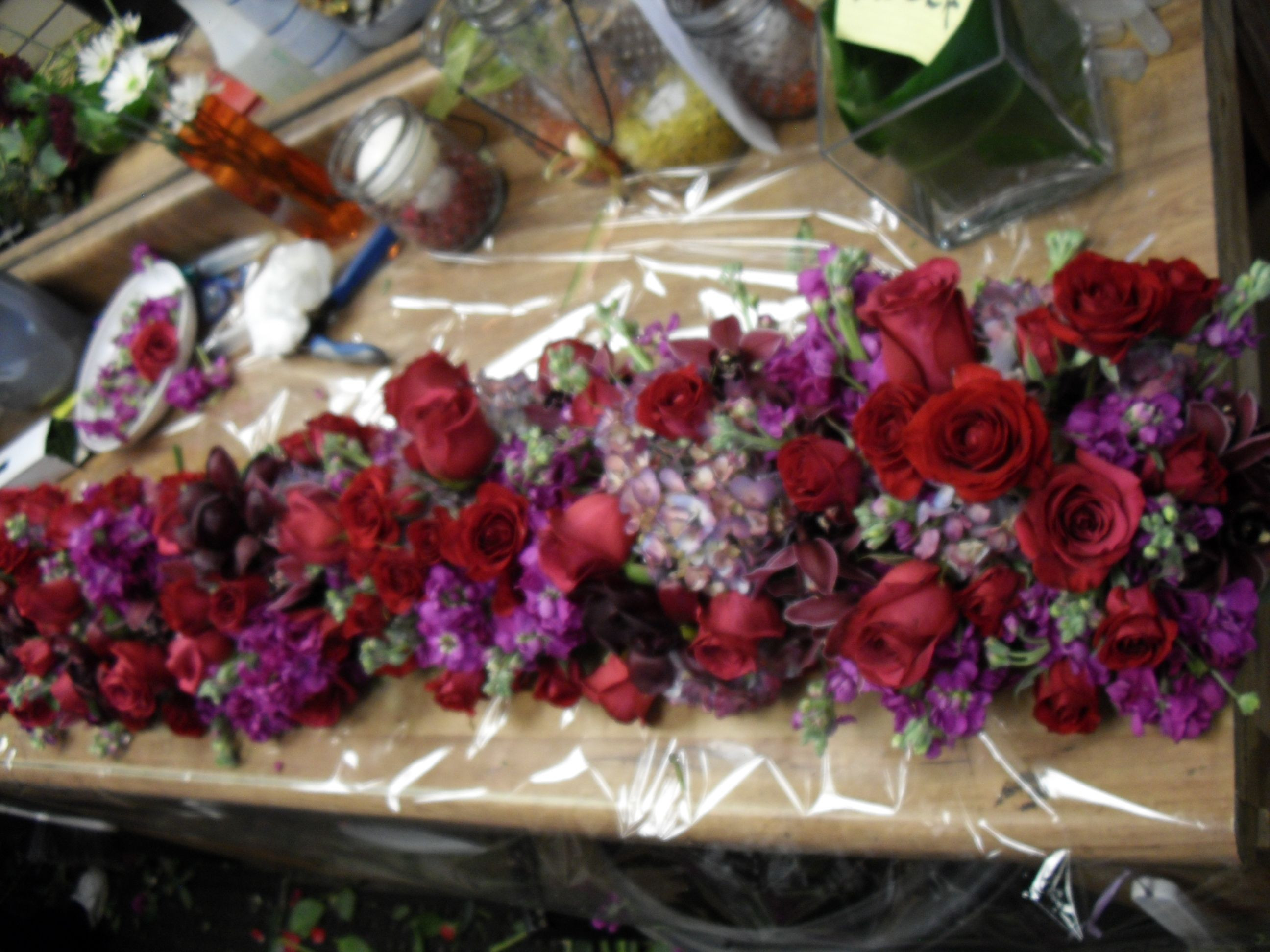 table centerpiece red and purple flower arrangement for wedding and event