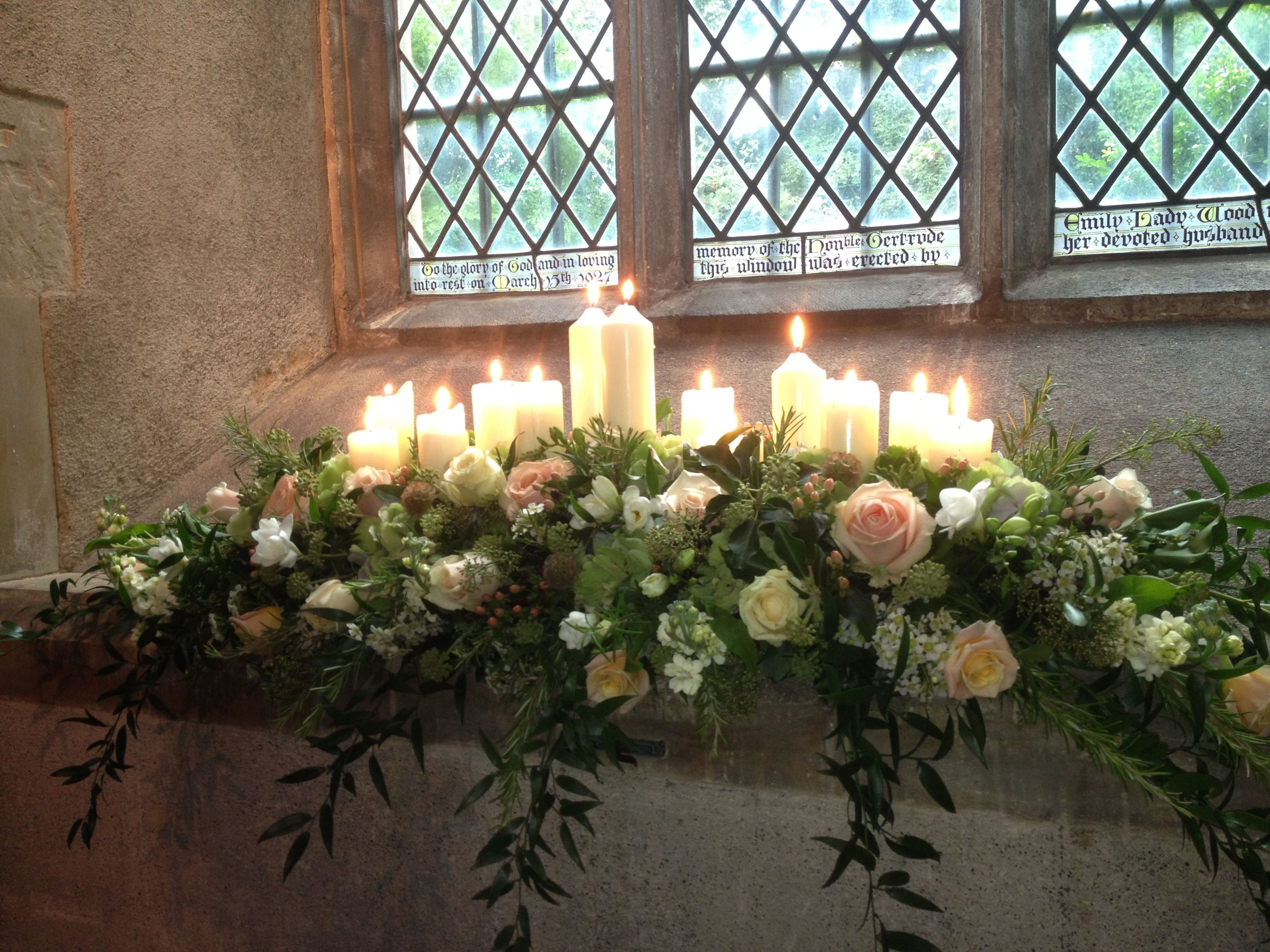 Windowsill Dressed With Candles And Cascading Flowers