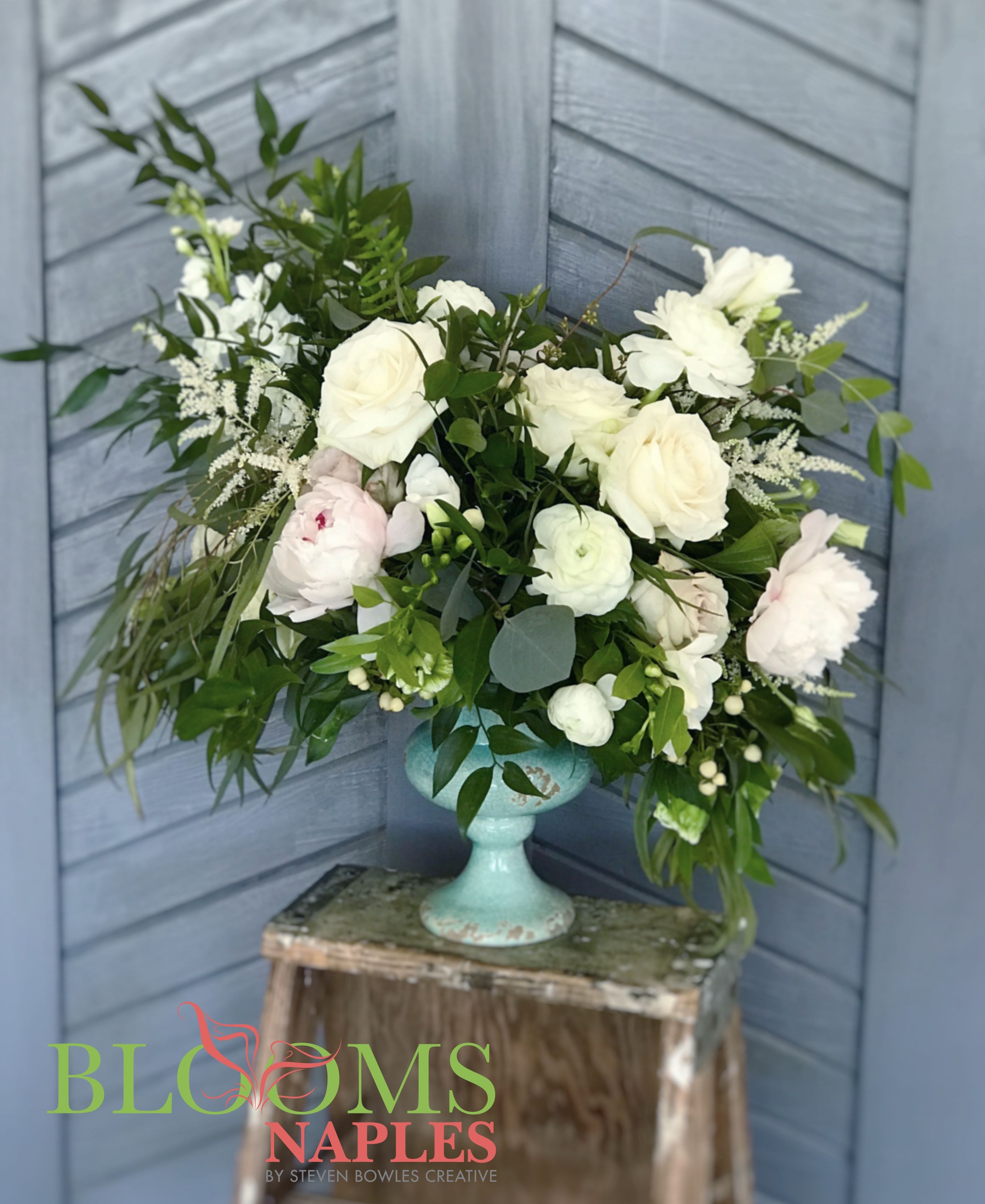 Soft and romantic floral arrangement in white Designed by BLOOMS NAPLES by Steven Bowles Creative Naples FL