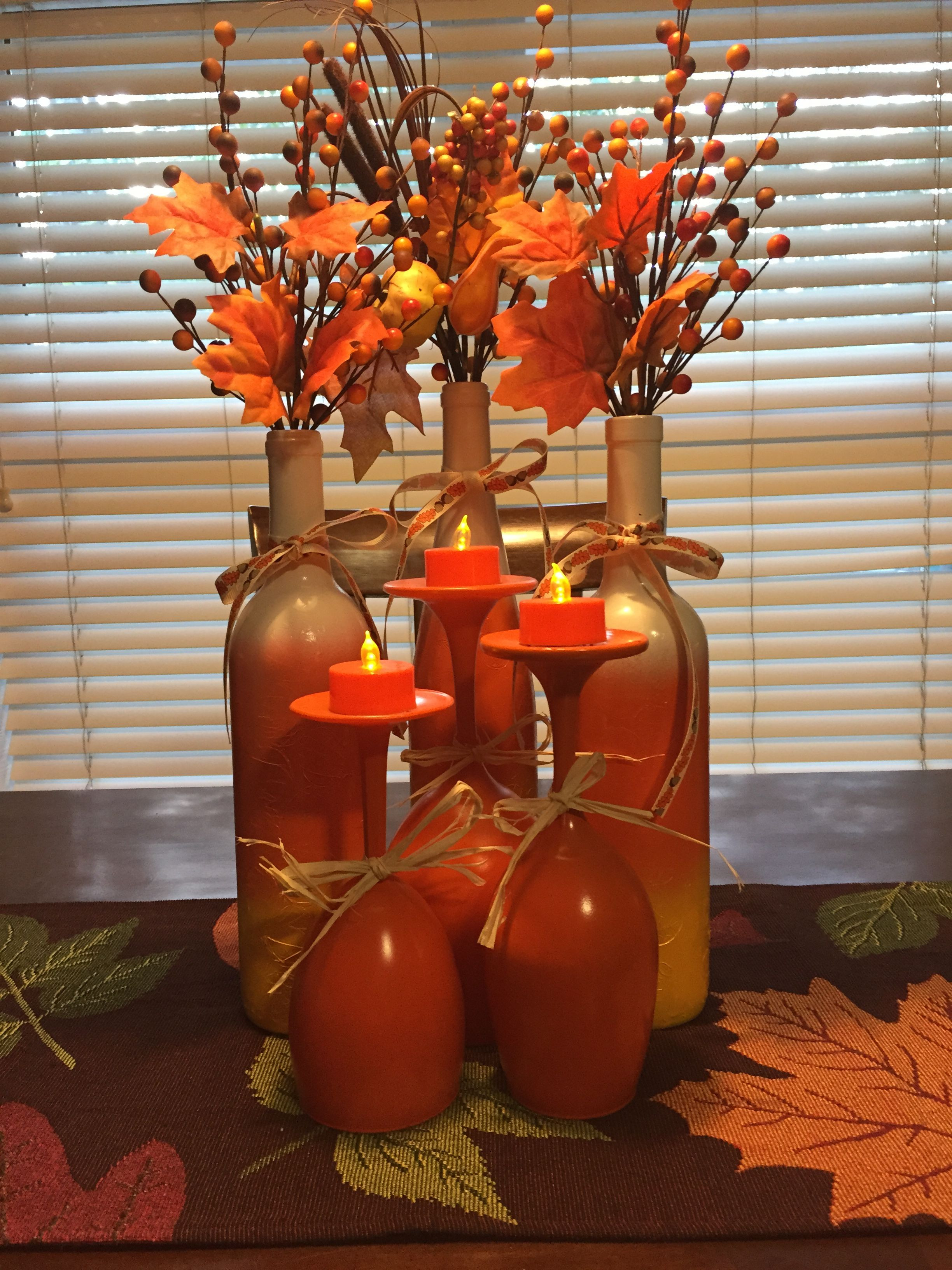 Tree wine glasses painted orange $ Tree battery operated orange tea lights wine bottles painted like candy corn $ Tree silk flowers and twigs