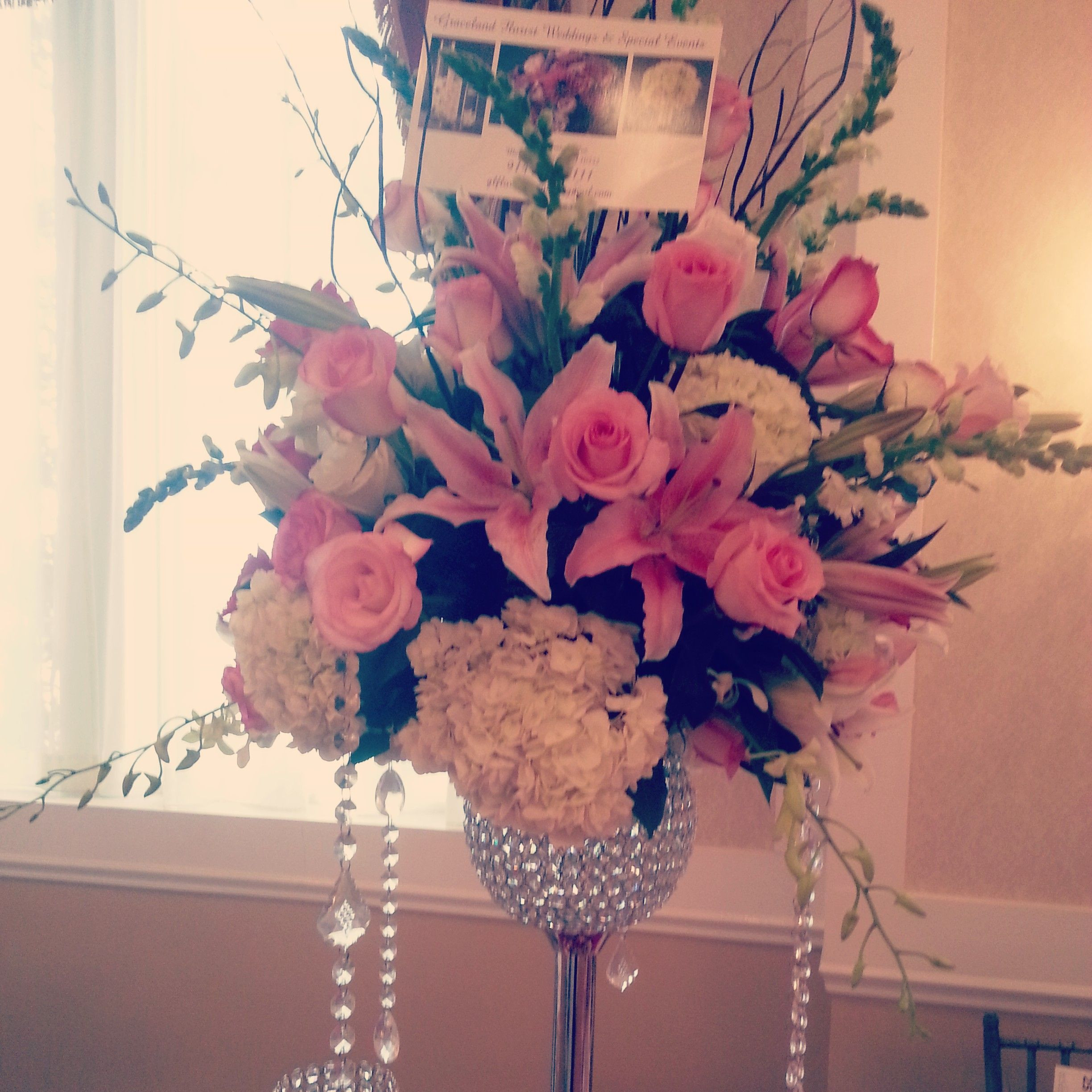 Stargazer lily wedding centerpiece with pink roses white hydrangea snap dragons and dendro