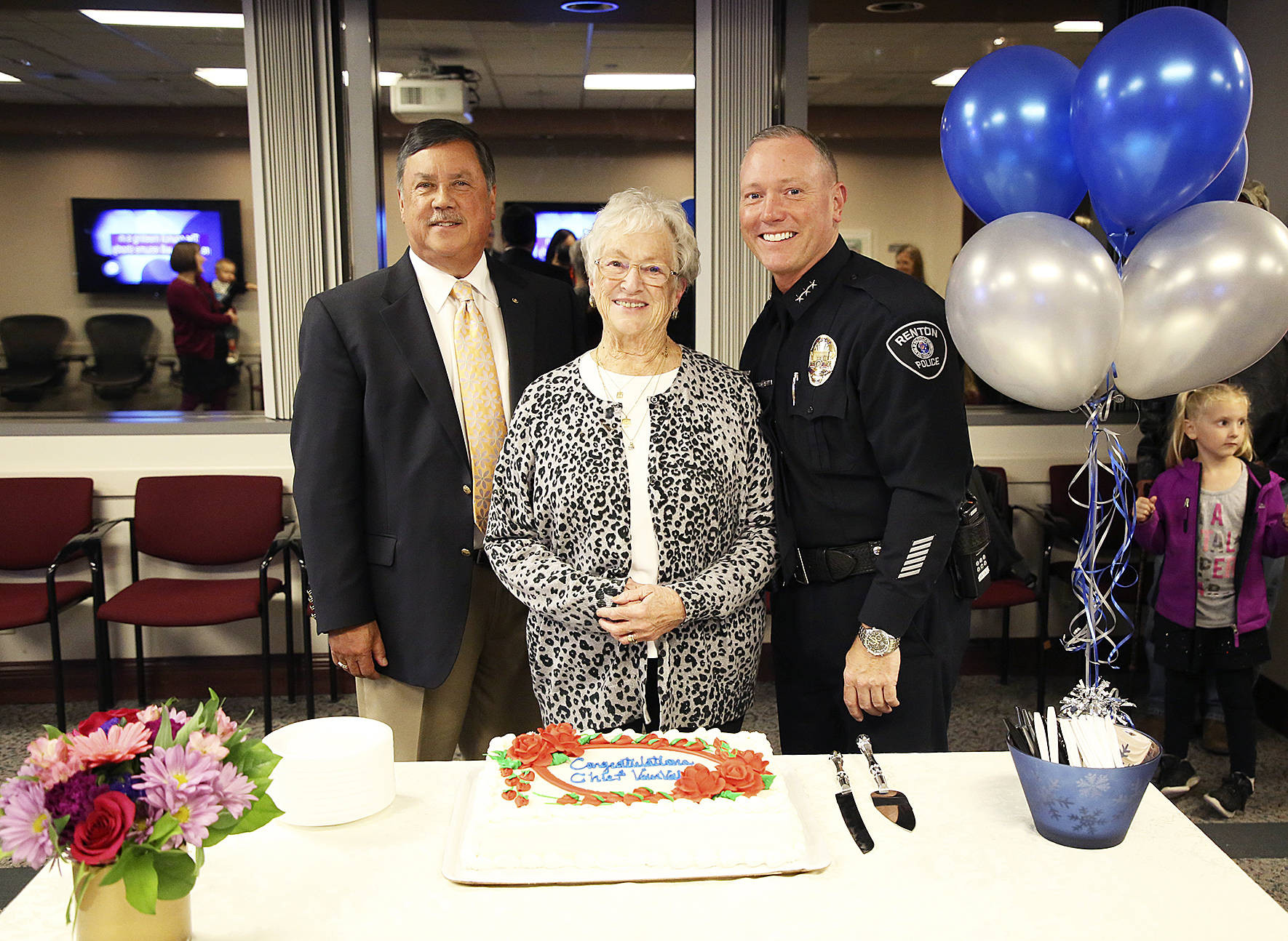 Mayor Denis Law Police Chief Ed VanValey and his mother Jo Ann VanValey pose at