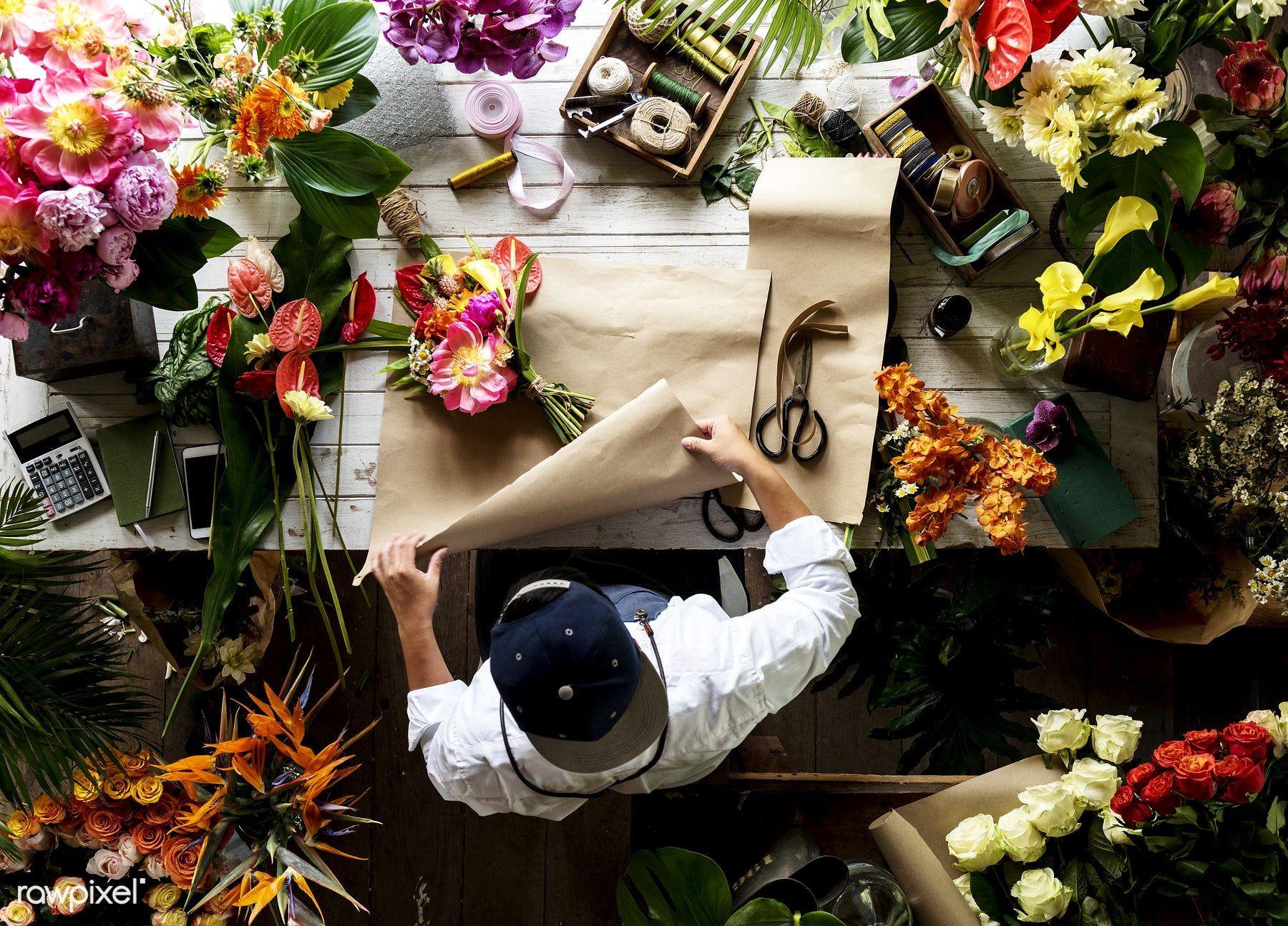 Florist making a flower arrangement in a flower shop
