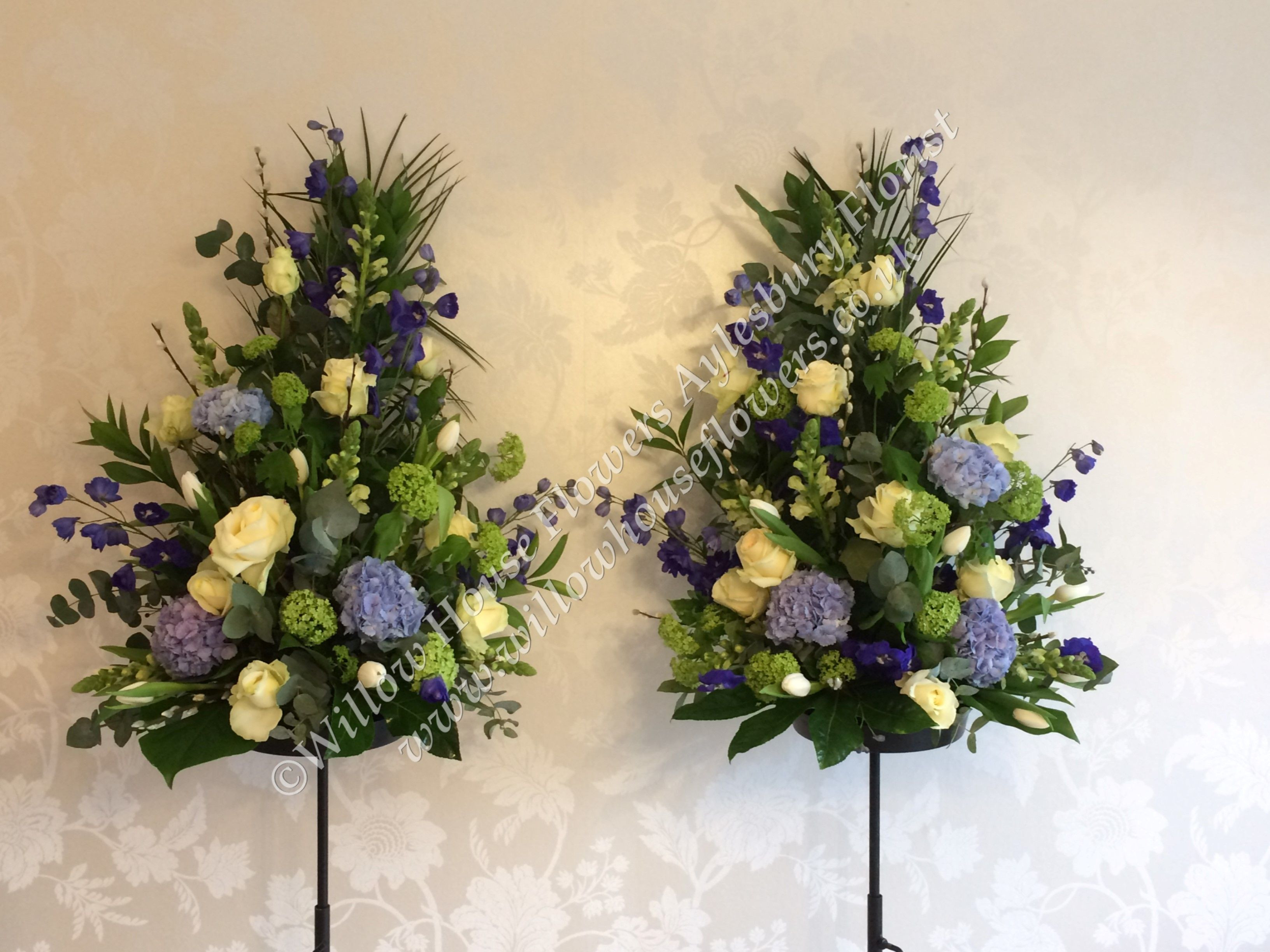Fresh flower floral arrangement church registry office pedestal funeral flowers blue hydrangea white rose designed and created by Willow House
