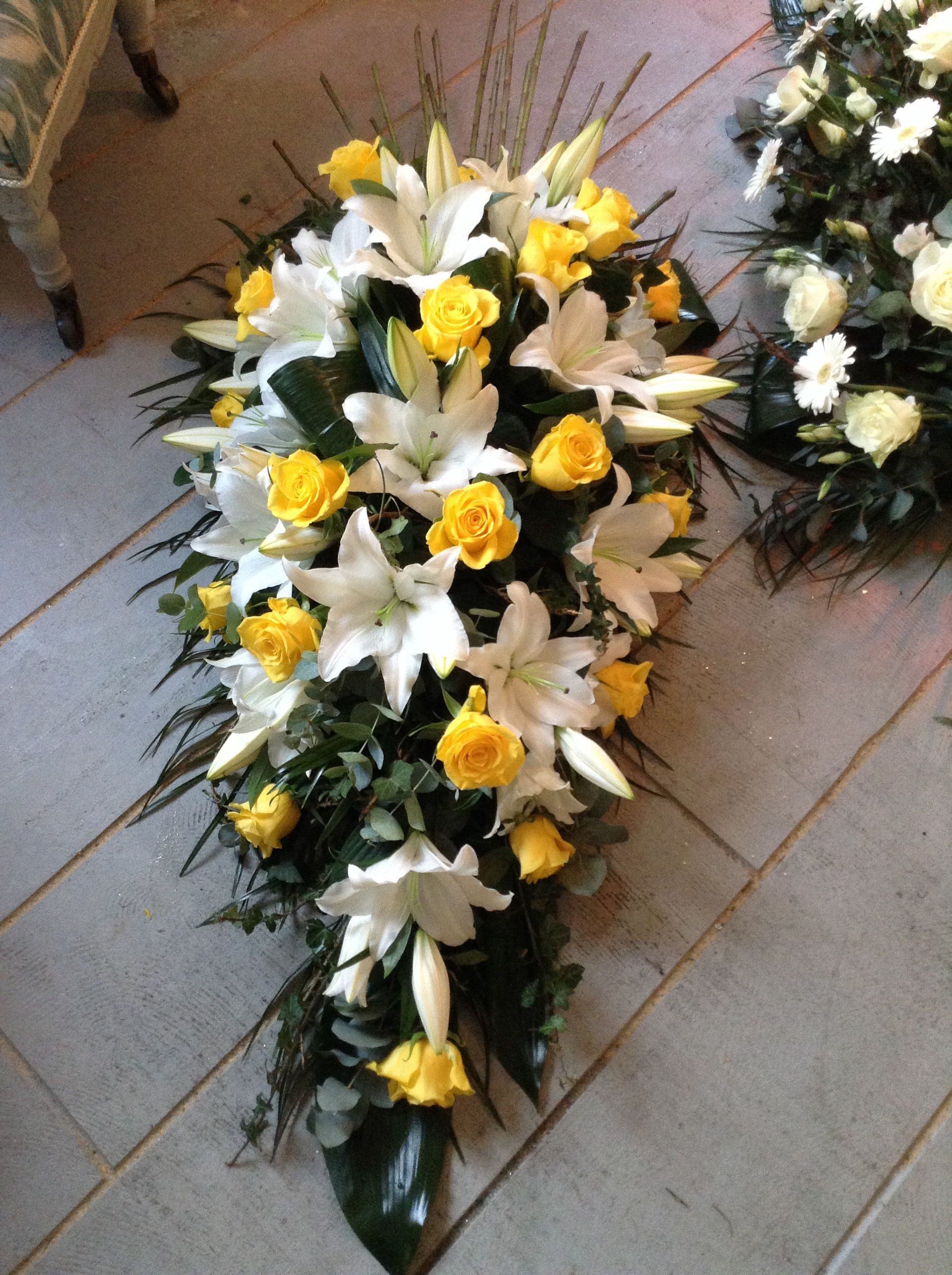 Funeral Flowers White lily and yellow rose funeral spray casket spray Funeral flowers