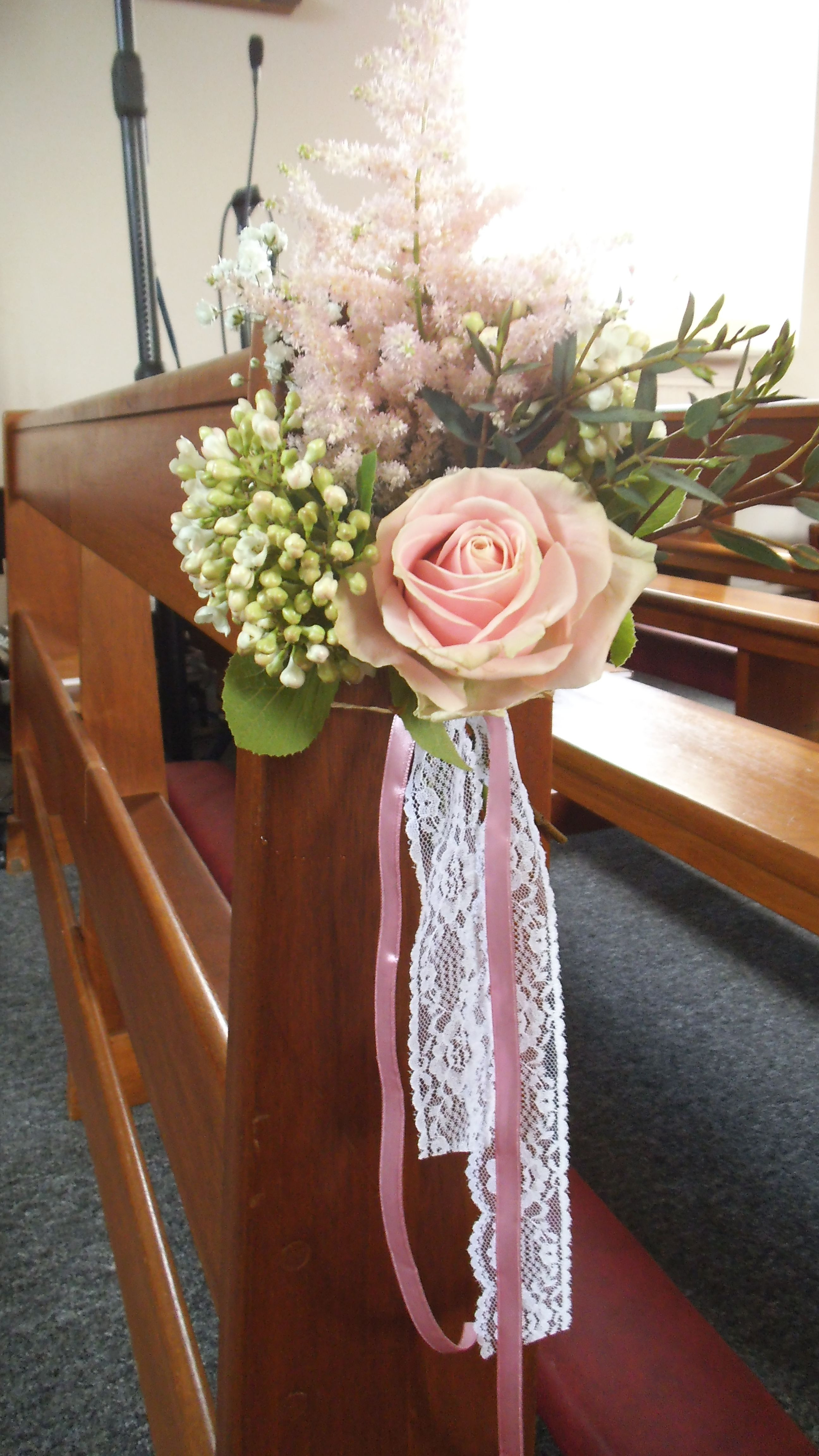 Pew end posy by The Posy Barn
