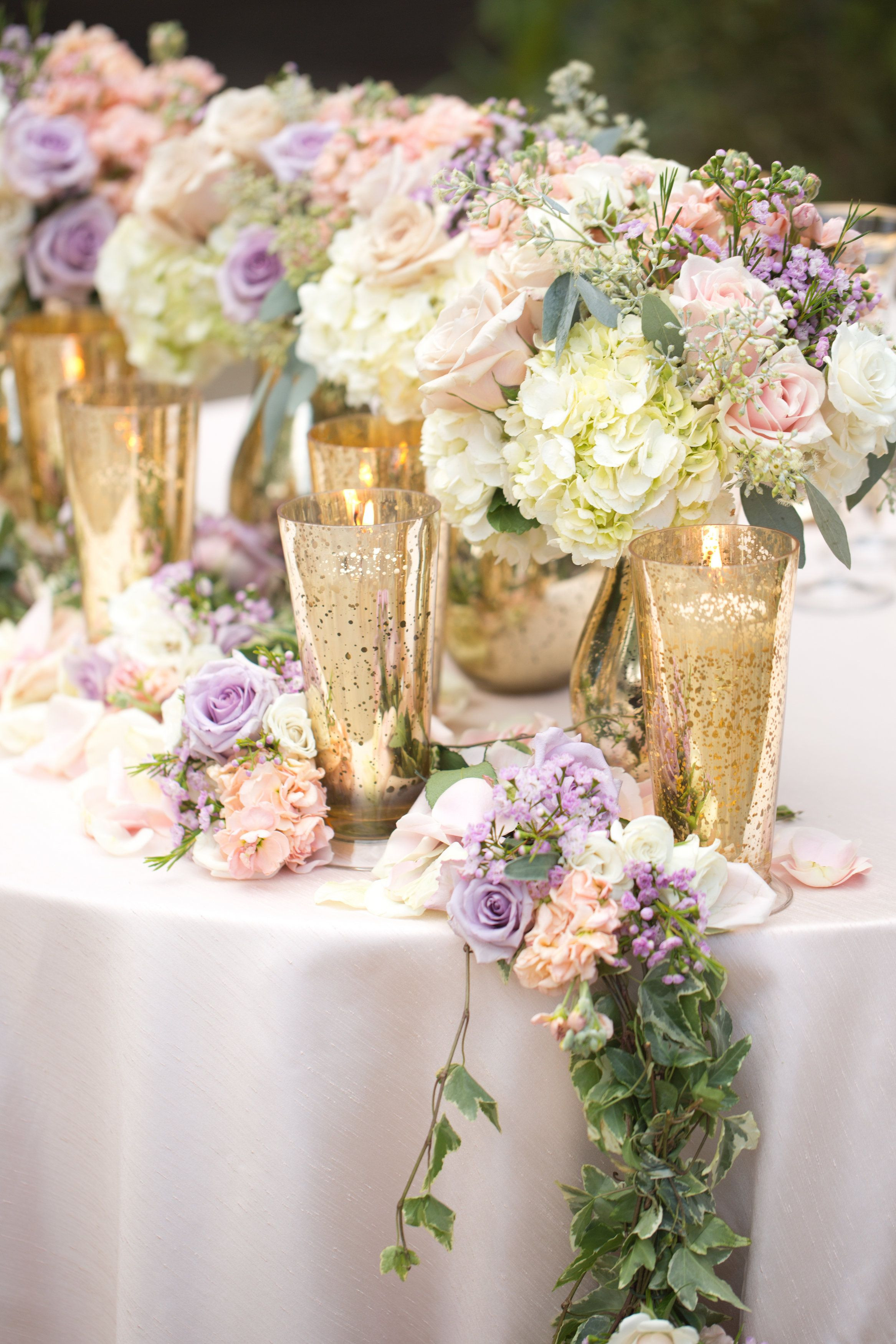 Lavender and blush pink roses white hydrangeas Floral garlands for the reception tables and sweetheart table Gold mercury glass vases