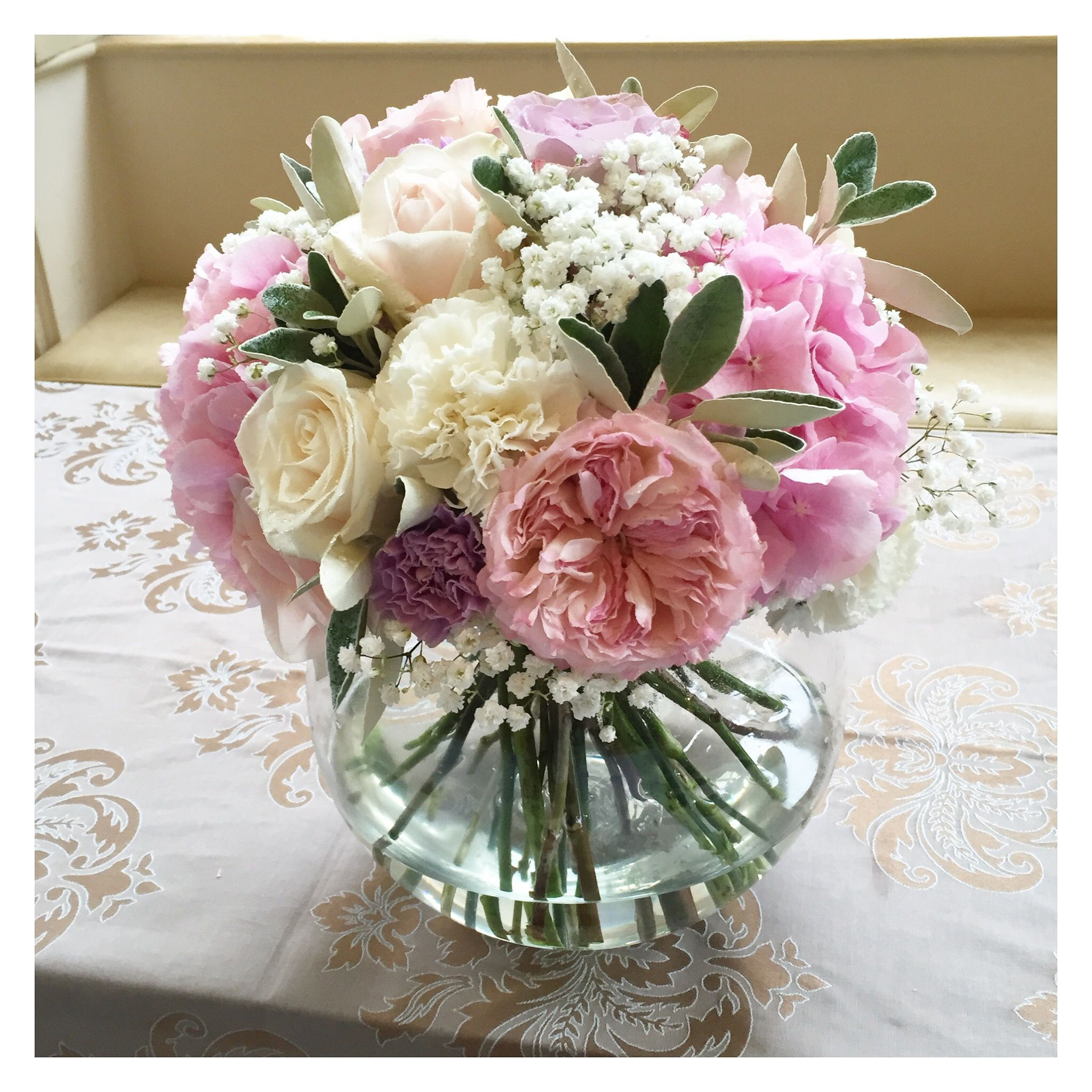 Pink rose hydrangea and peony fish bowl wedding centrepiece Surrey wedding flowers by Boutique Blooms floral design