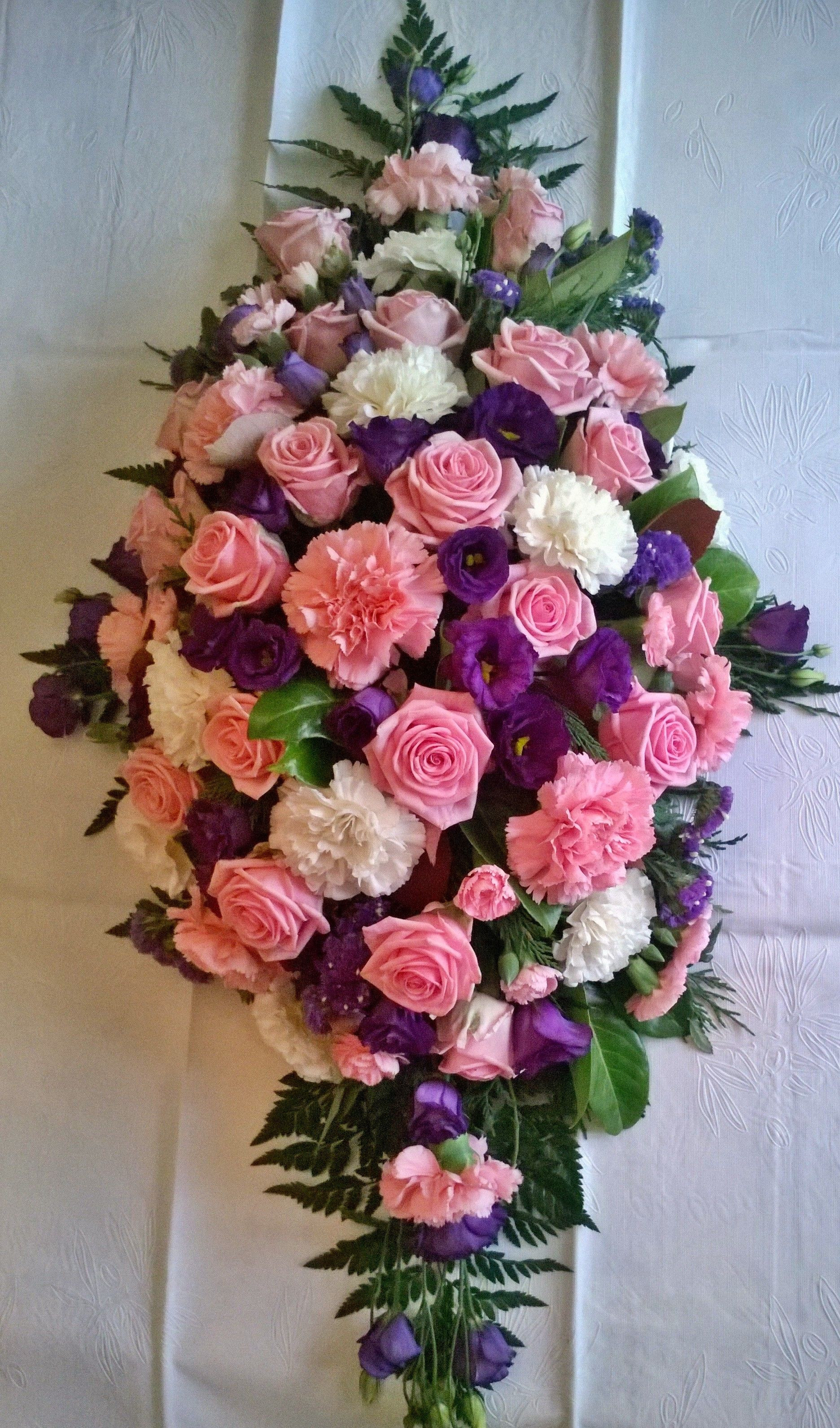 pink and white roses and carnations purple lisianthus coffin funeral spray