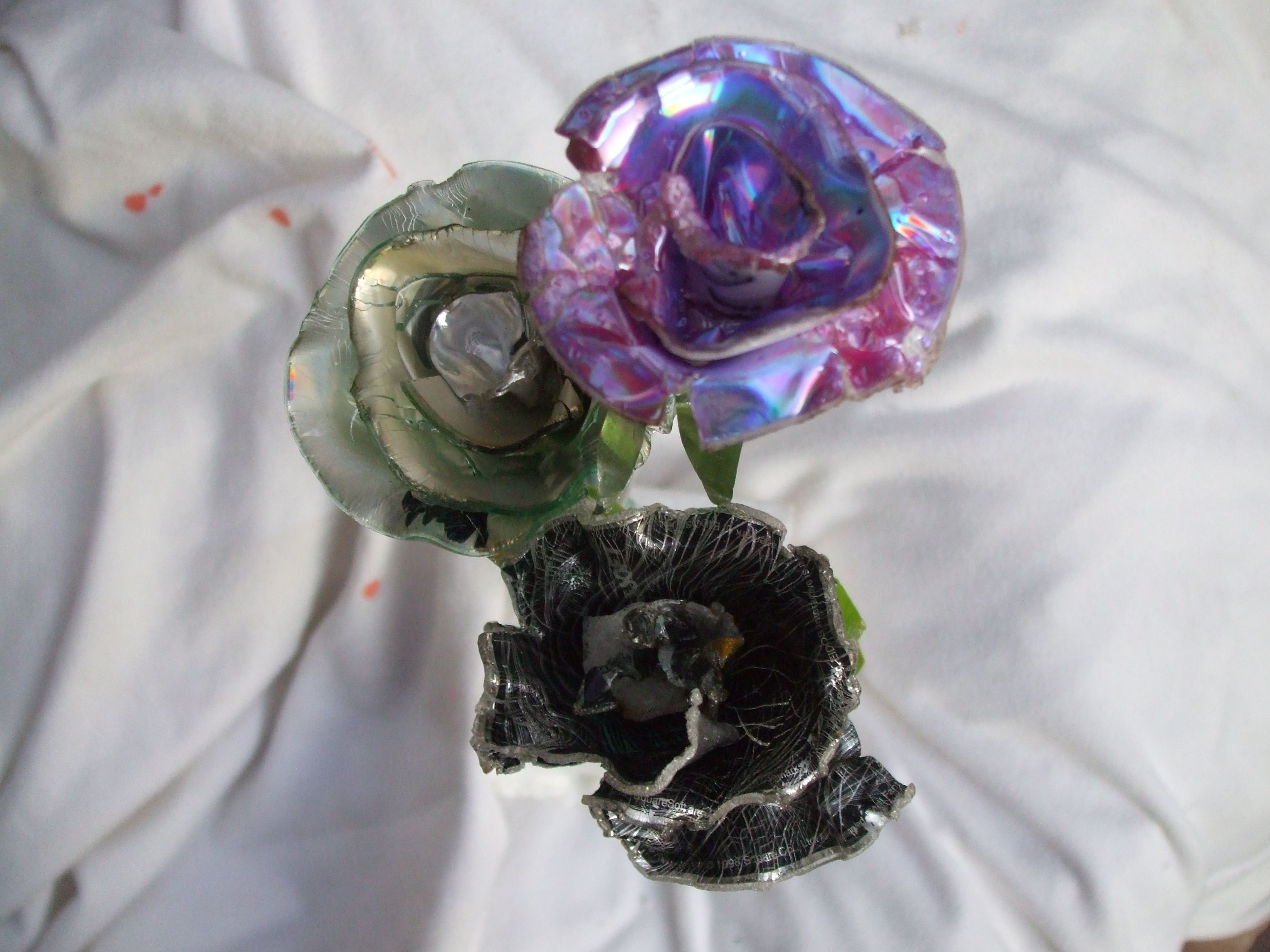 Melted and formed cds into flowers recycled cds DIY flowers
