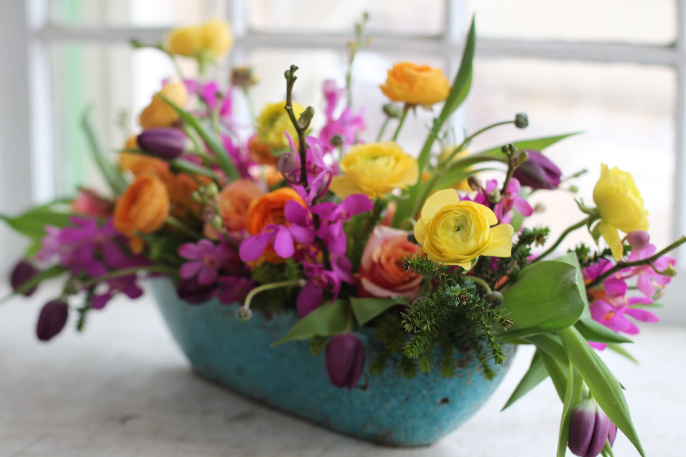 spring flower arrangement ranunculus orchid tulip yellow orange fuschia hot pink purple