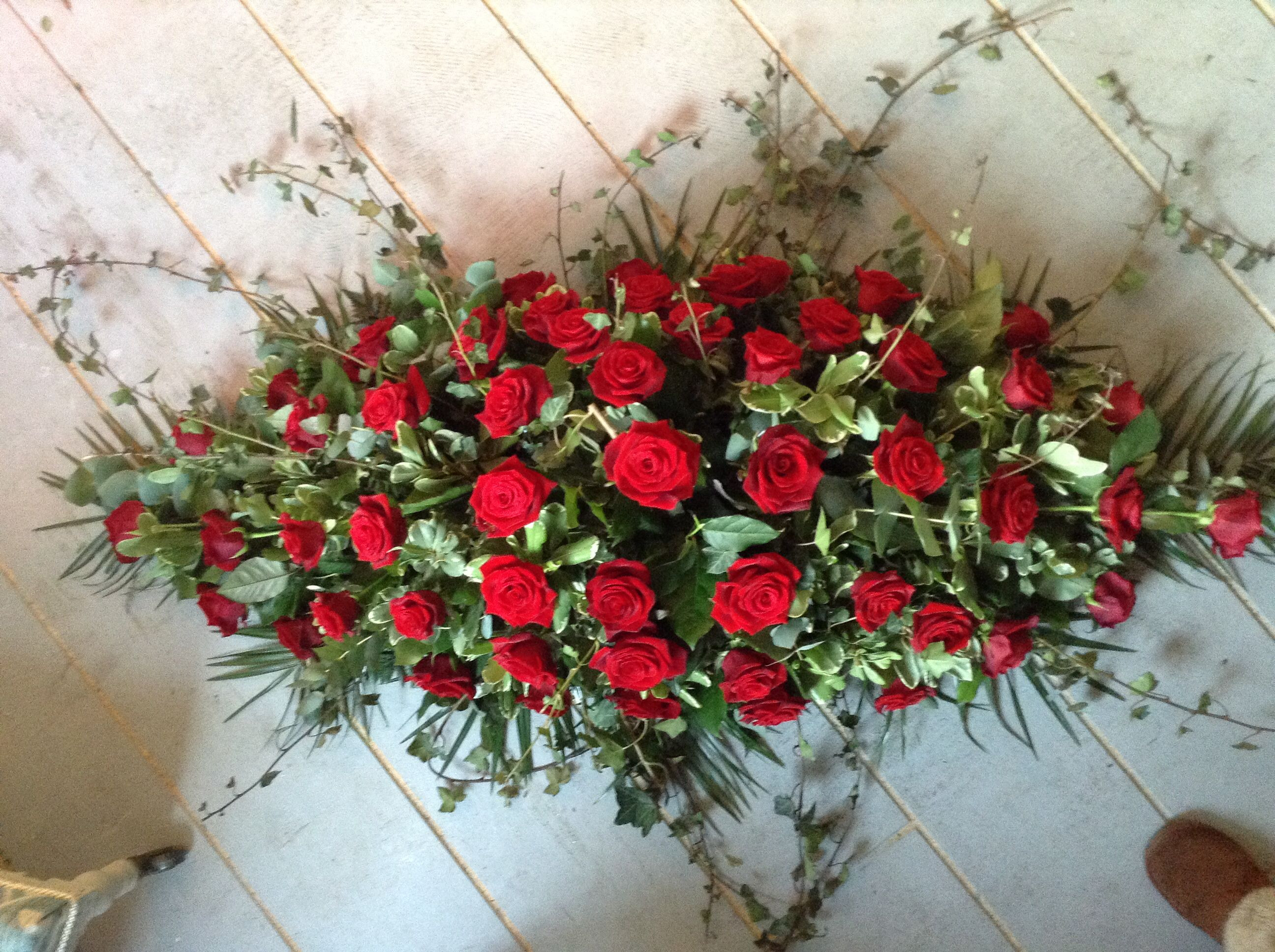 Red rose and red carnation funeral spray coffin spray casket spray funeral flowers