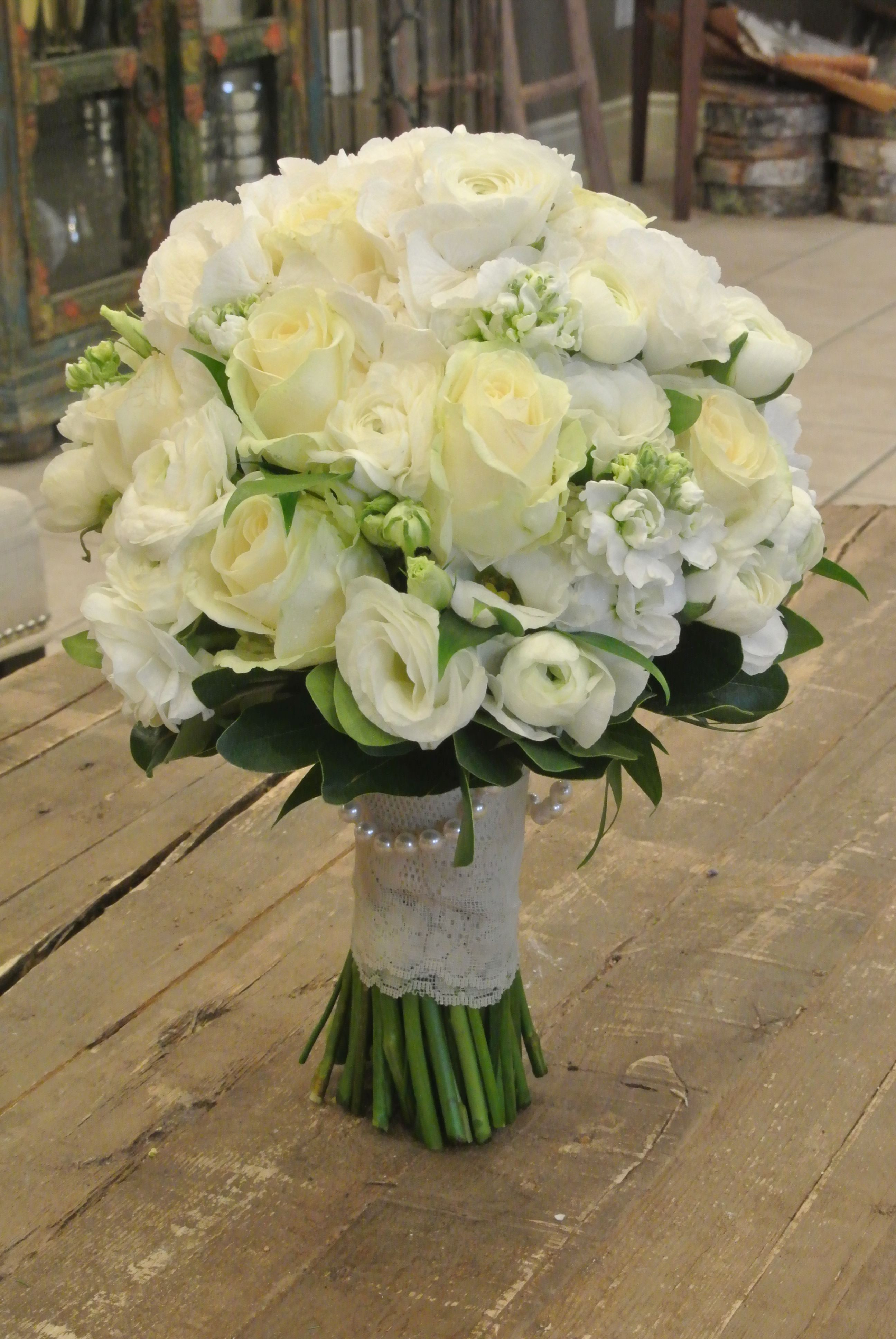 Bridal bouquet with roses ranunculus lisianthus stocks and hydrangea Designed by For Me Not FLowers