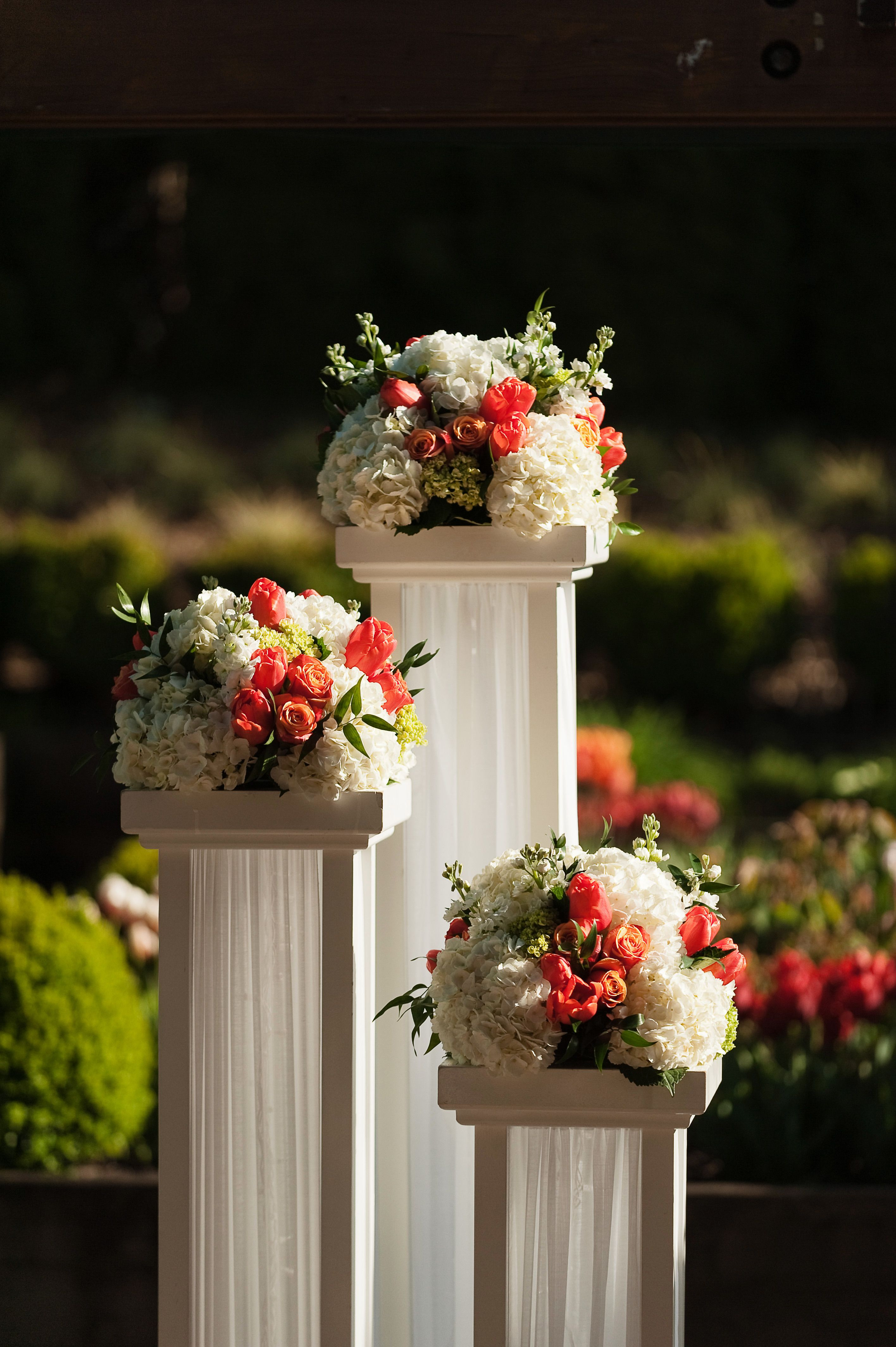 Discover thousands of images about Good for a backdrop to a ceremony in a garden or somewhere that has no focal point tall box towers with florals on top