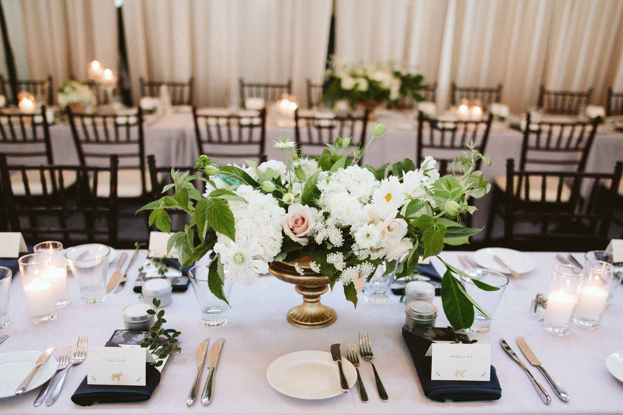 Flora Nova Design Seattle wedding reception centerpiece with white floral and greens