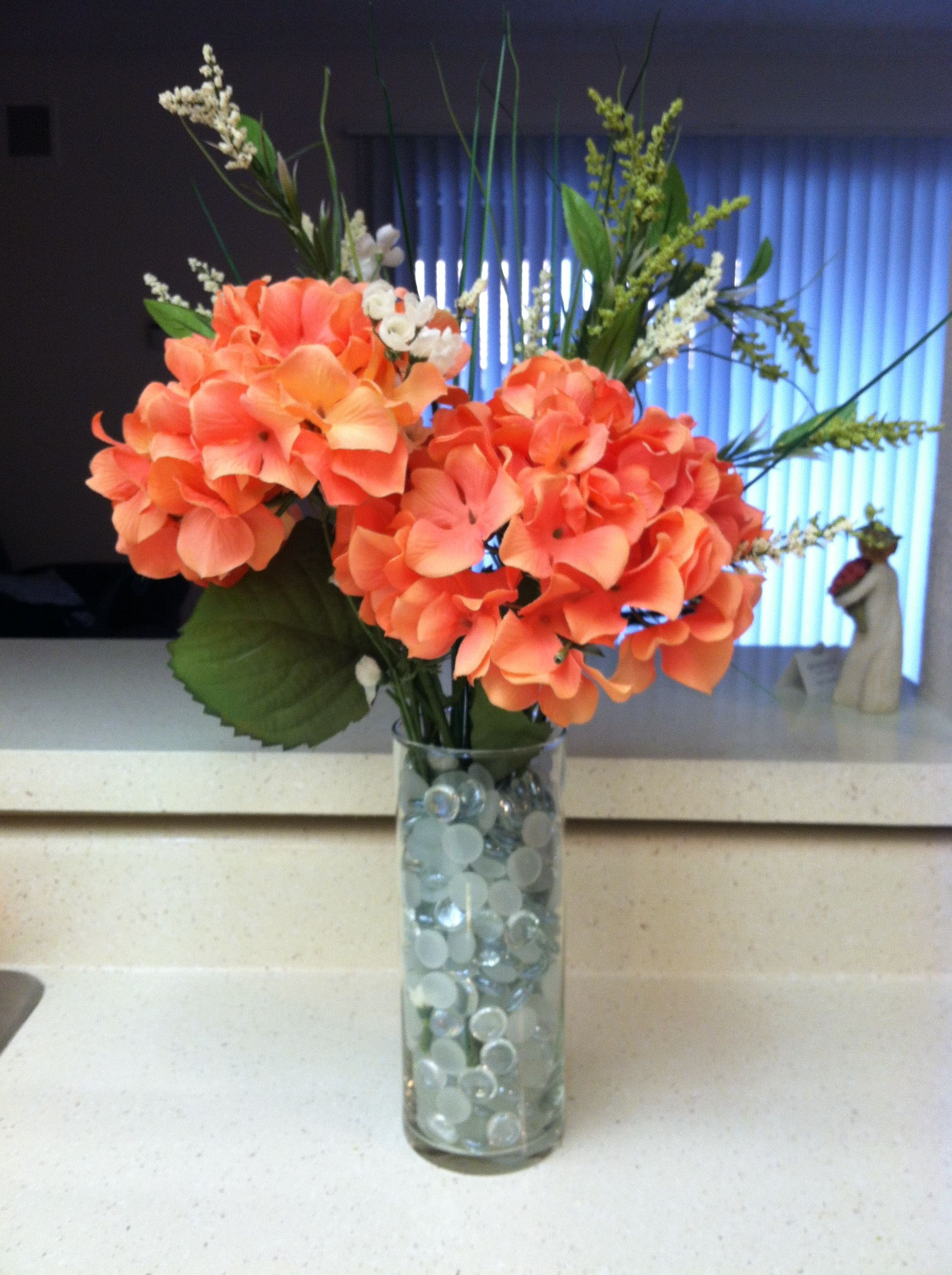 Fake Flower Arrangement using Dollar store vase glass pebbles flowers and greenery