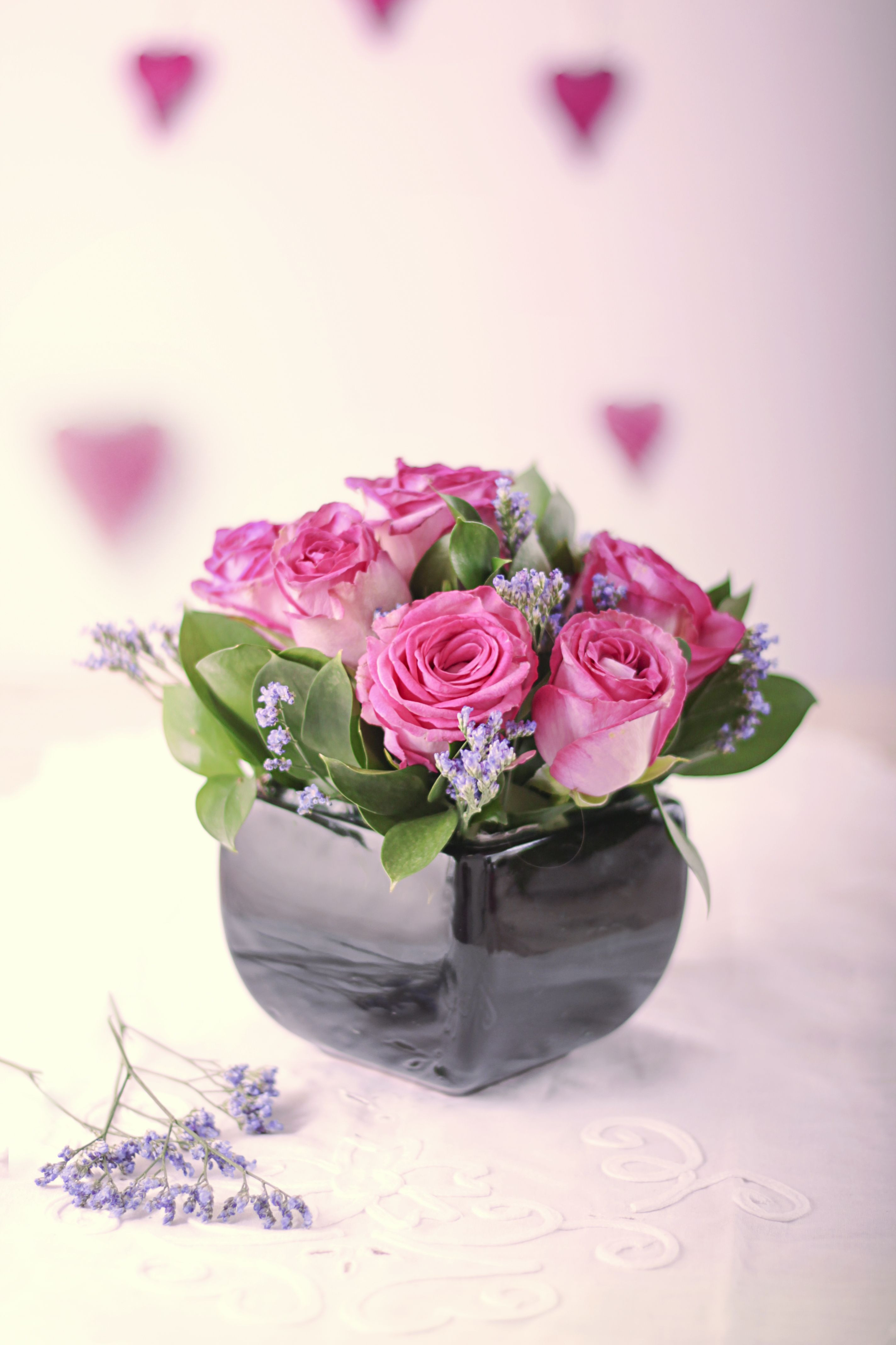 Petite Pink Roses in a small glass vase